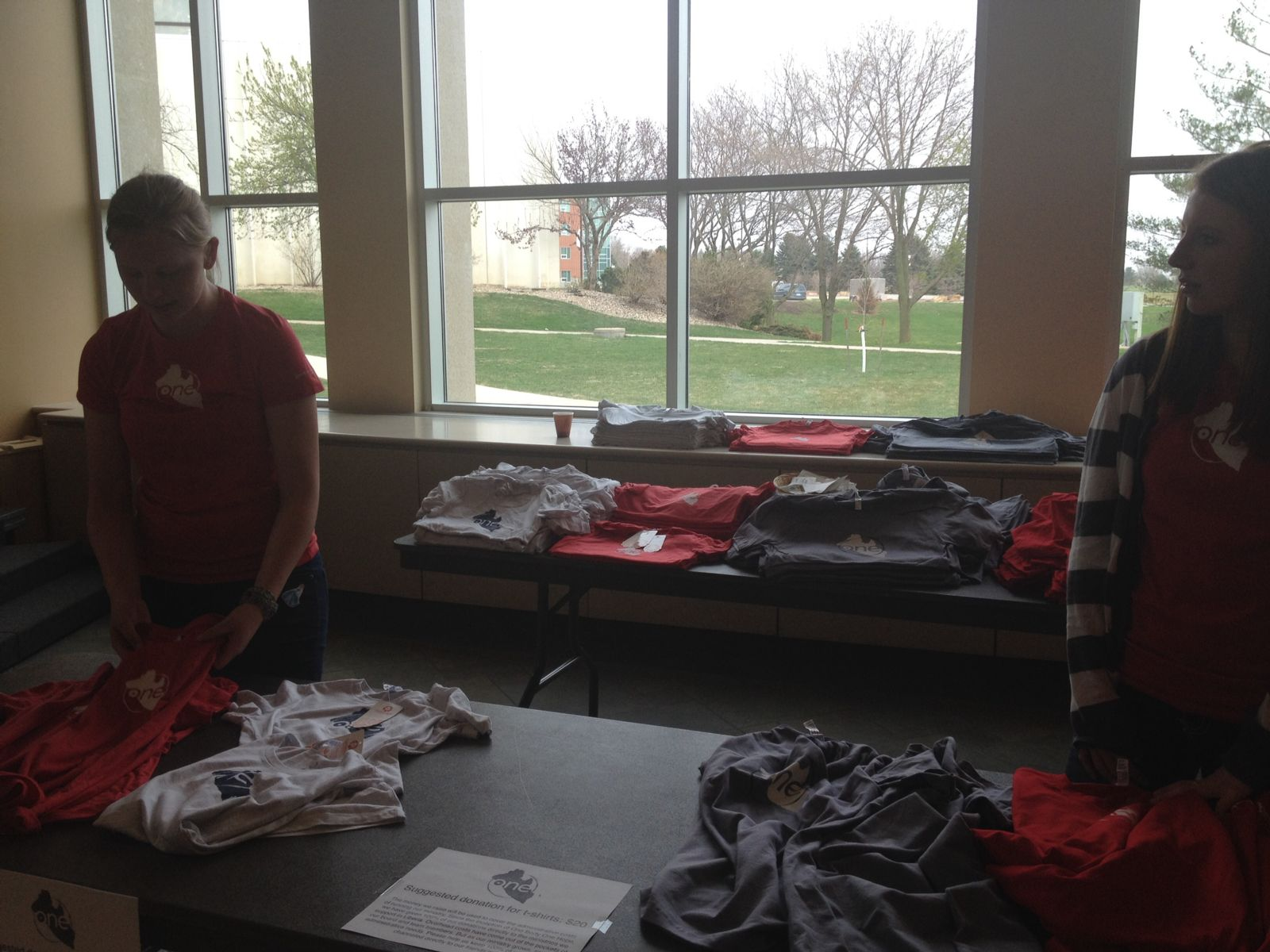 Preparing the t-shirt displays to help cover administration costs, so all donations can go directly to our sister community.