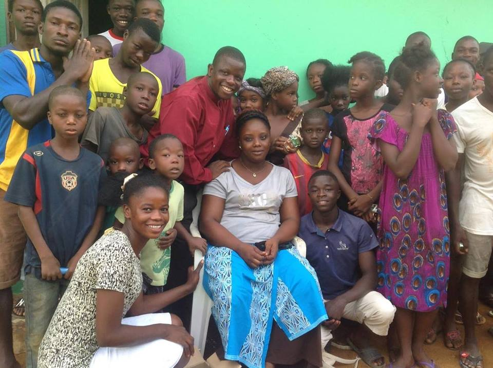 Emannuel and Fatu with children from the orphanages