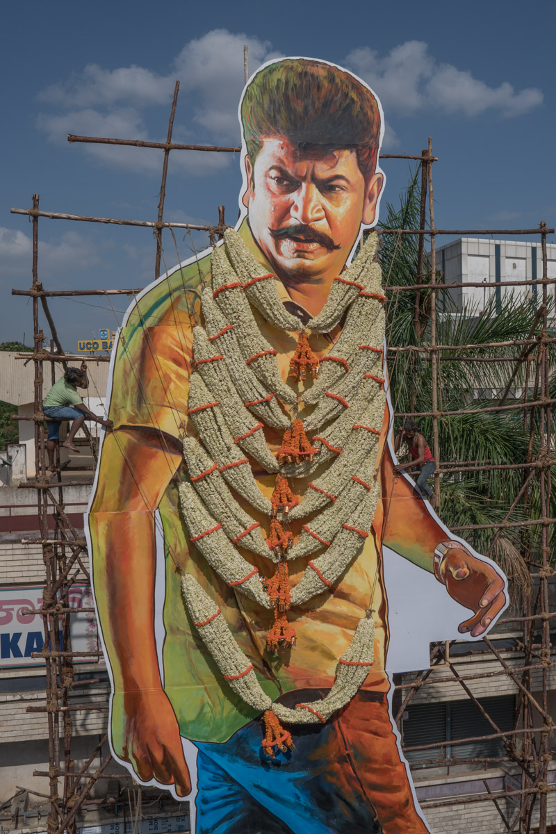 Workers garland a giant cut-out of Kannada actor Shivrajkumar