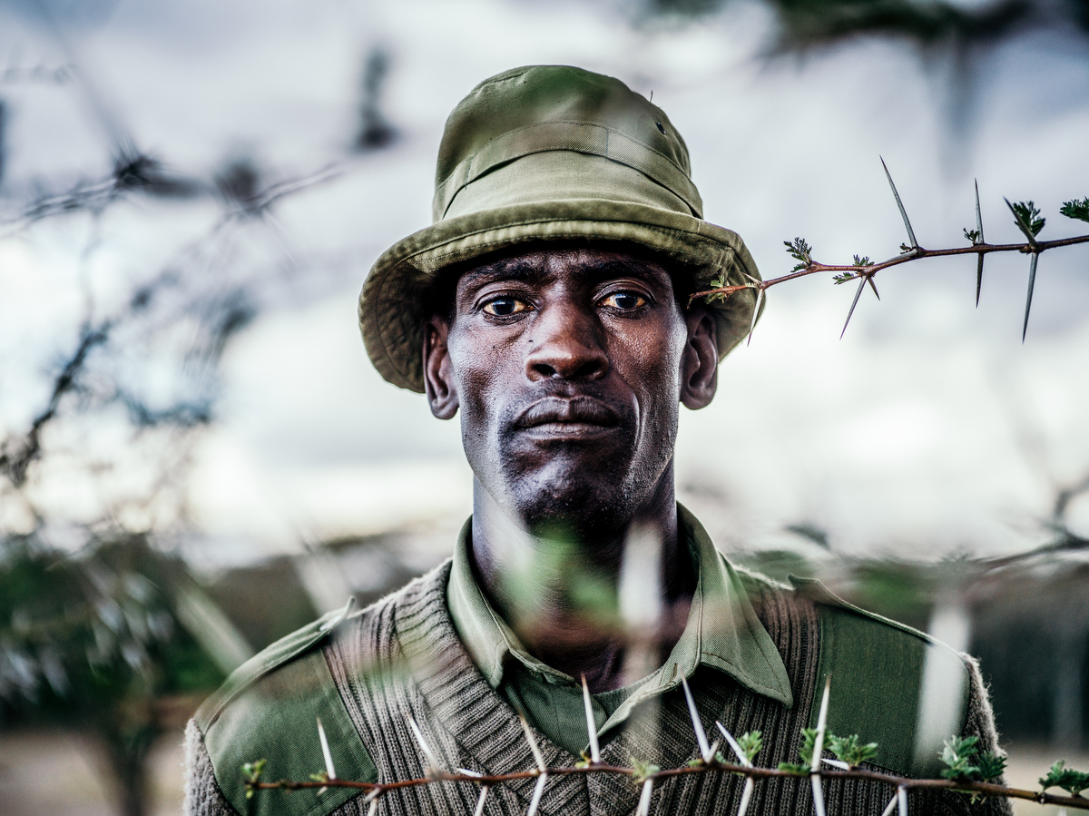 A portrait of Peter Esegon, 47, one of the primary caretakers of Fatu and Najin at Ol Pejeta conservancy in Central Kenya.  Esegon has worked at the conservation for 20 years and his job entails looking after and educating visitors about the rhinos.