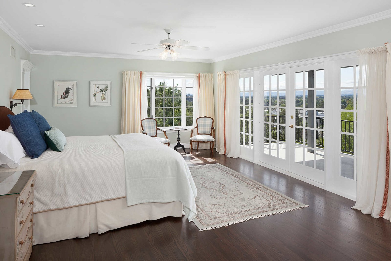 The exceptional master suite opens to a veranda and includes two walk-in closets.