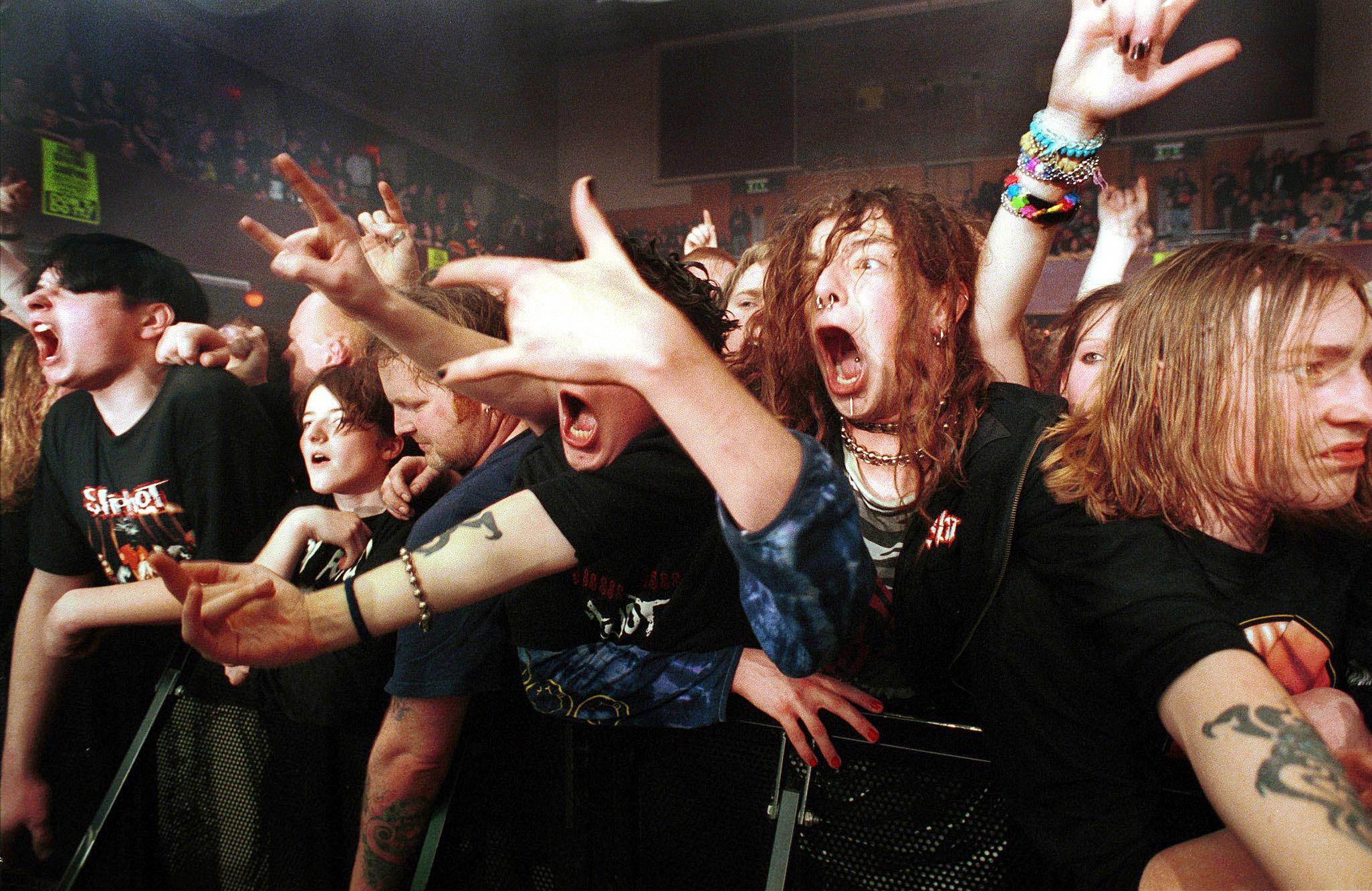 "Fans at a ""Slip Knot"" concert"