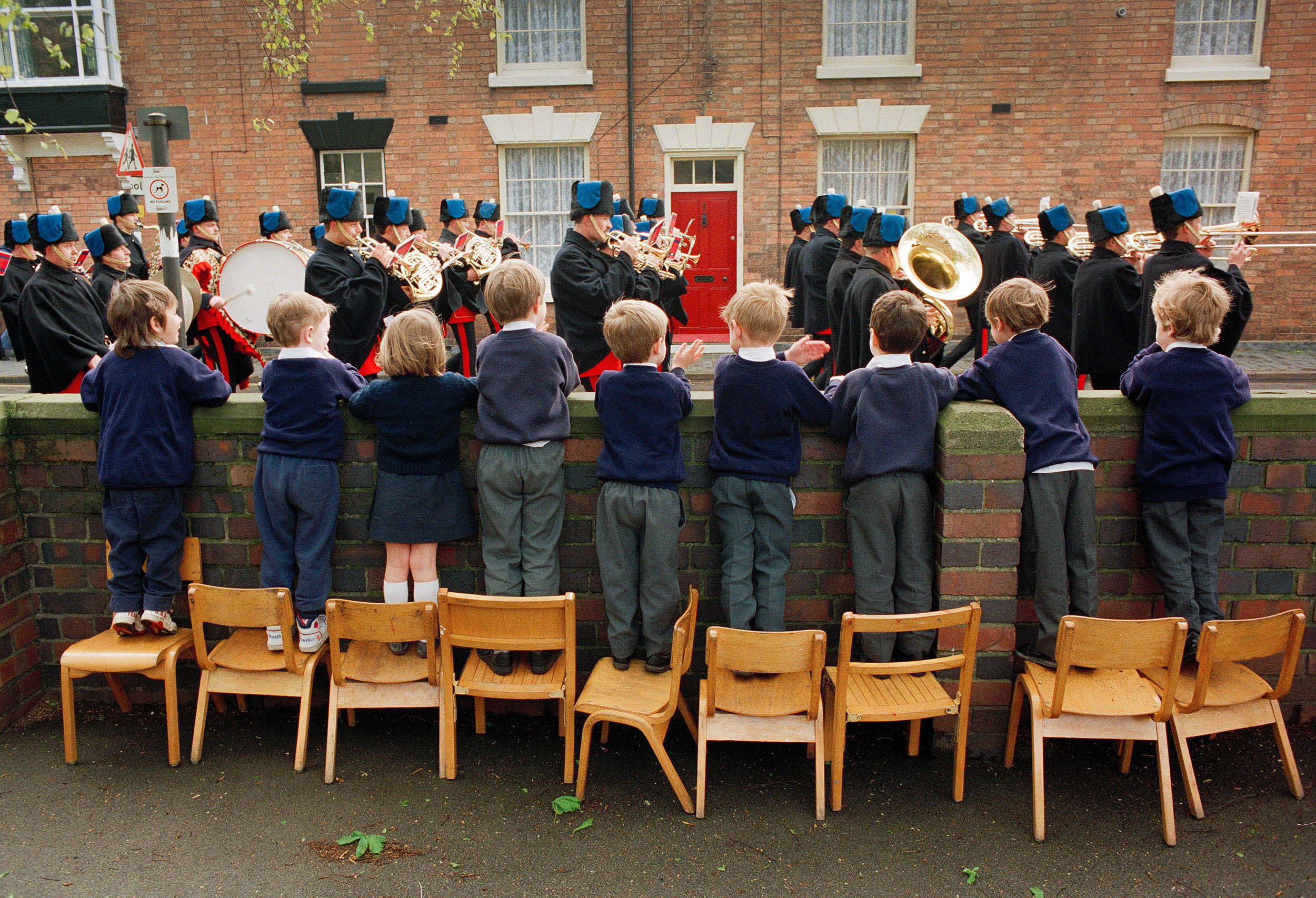 School children watch a marching brass band celebrating the anniversary of Shakespeare's birthday in Stratford-upon-Avon