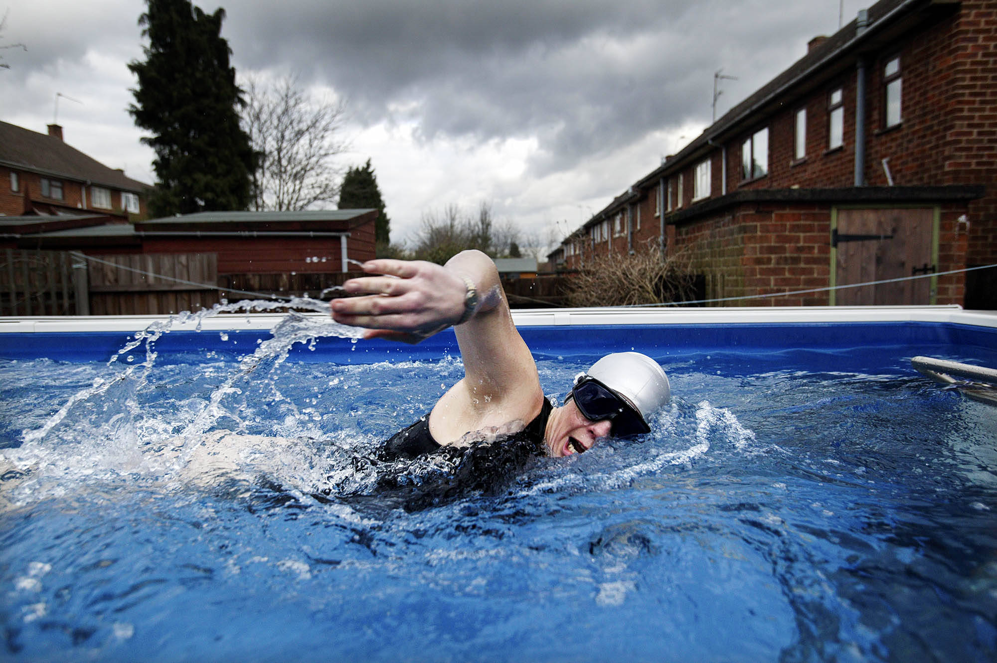 "Long distance swimmer Julie Bradshaw training in her ""treadmill"" pool in her back garden"