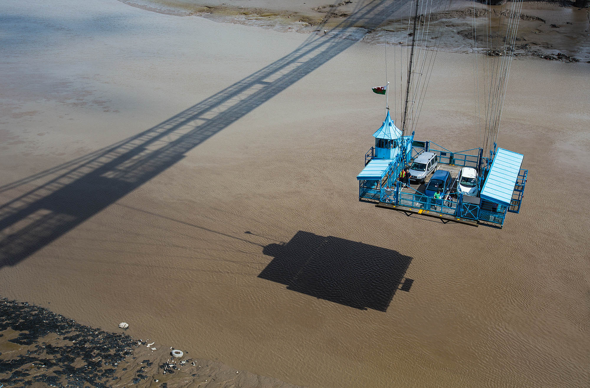 A gondola suspended beneath the Newport Transporter Bridge in Wales