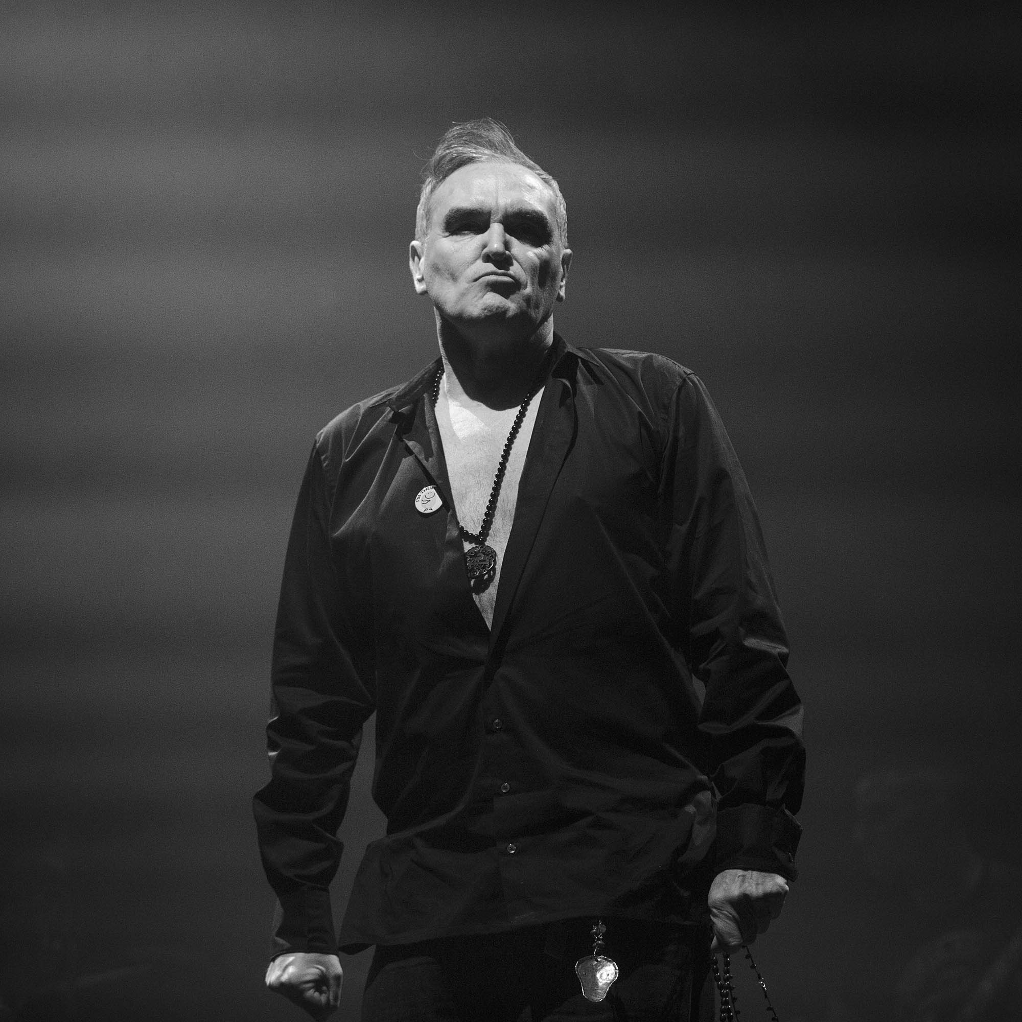 Morrissey scowls at the audience as he walks on stage at the NEC, Birmingham