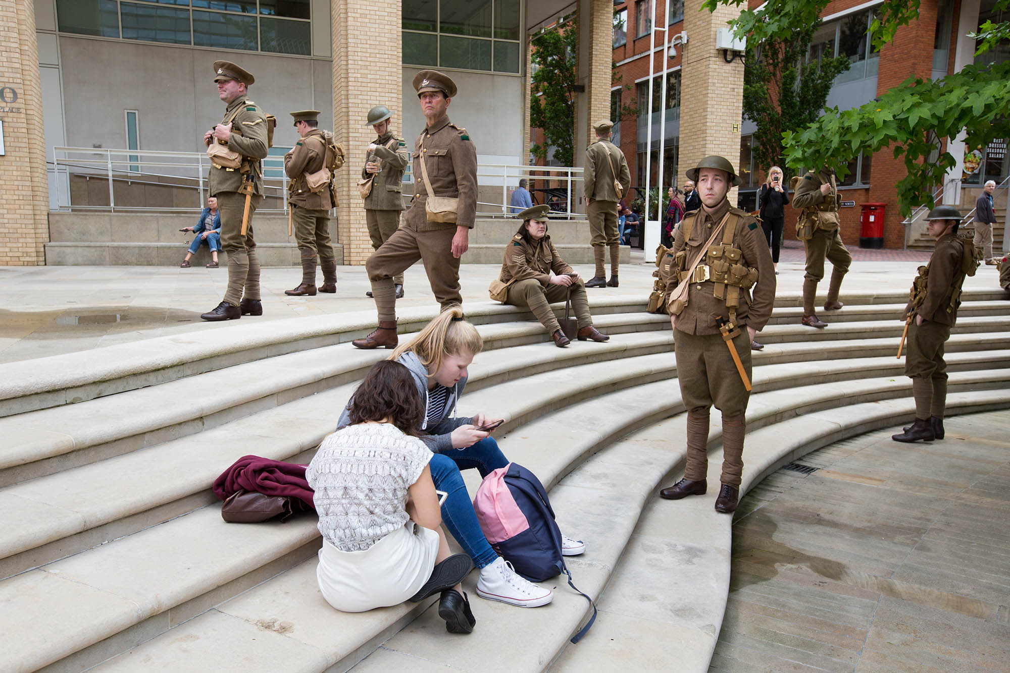 "Artist Jeremy Deller's project ""We're Here Because We're Here"" took place on 1 July 2016. Over 2000 people took part in a national memorial to mark the centenary of the first day of the Battle of the Somme. The participants, representing the shell-shocked fallen soldiers, appeared throughout Britain."