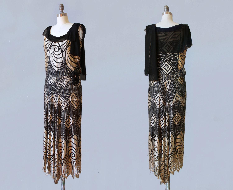Black net and metallic gold silk dress with Art Deco shell motif. 1920s.