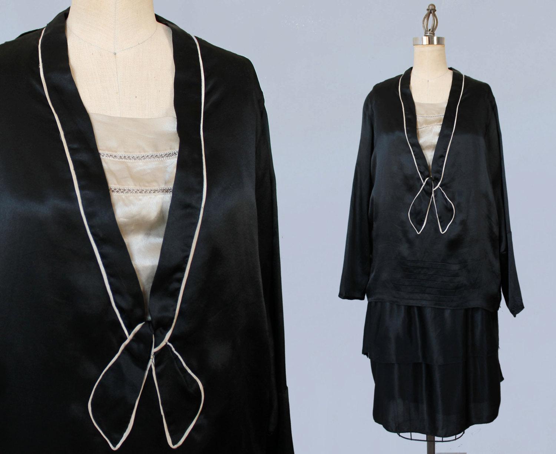 Black and cream silk trompe l'oeil two piece dress. 1920s.
