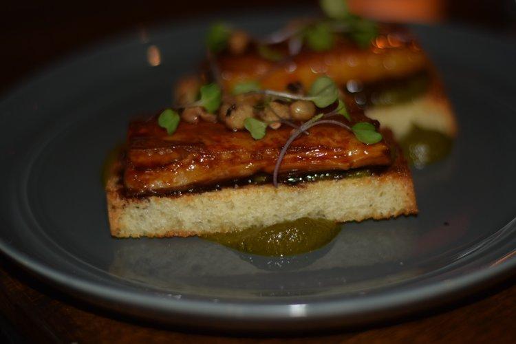 Pork Belly: toast, sorghum glaze, braised collard green puree, black eyed peas