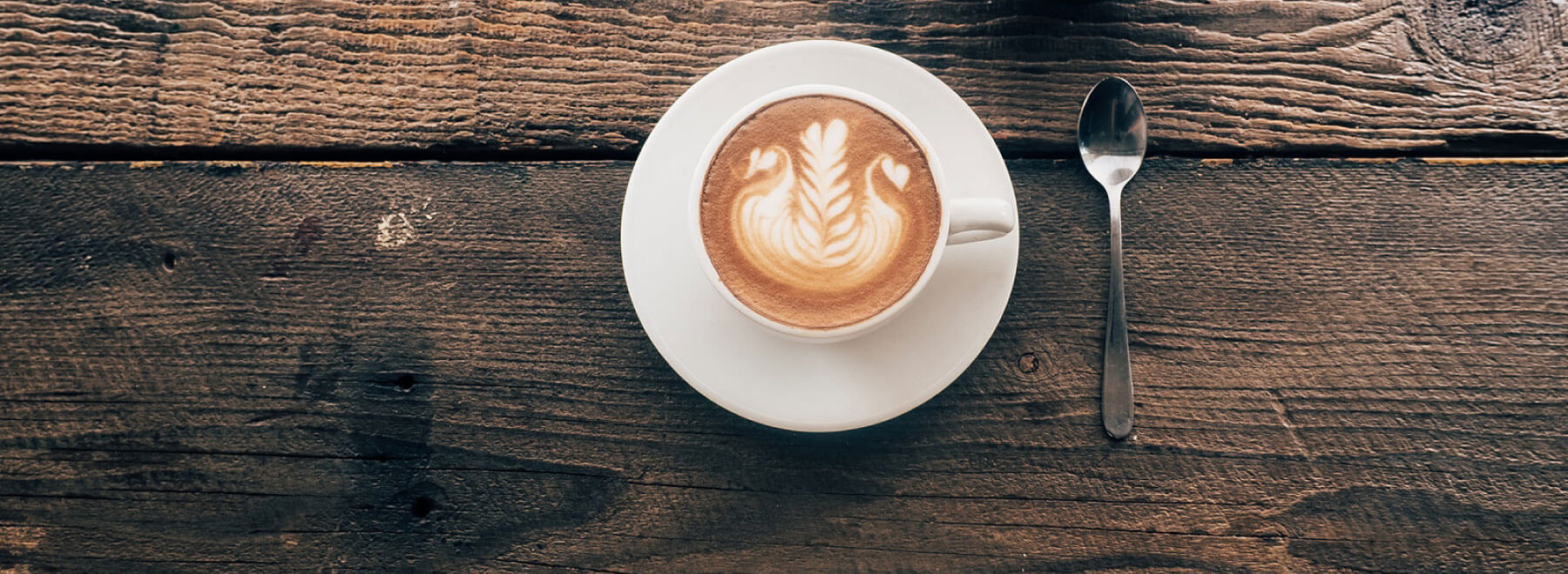 coffee-mug-on-rustic-table.jpg