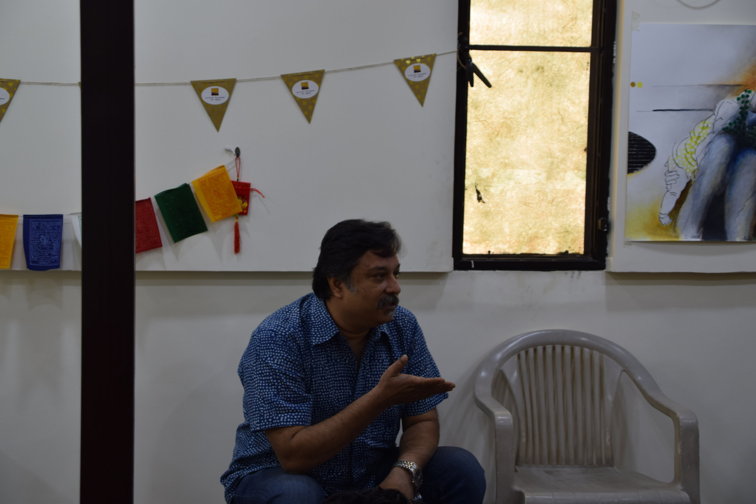 Curator Anoop Kamath responds to a point during the discussion.