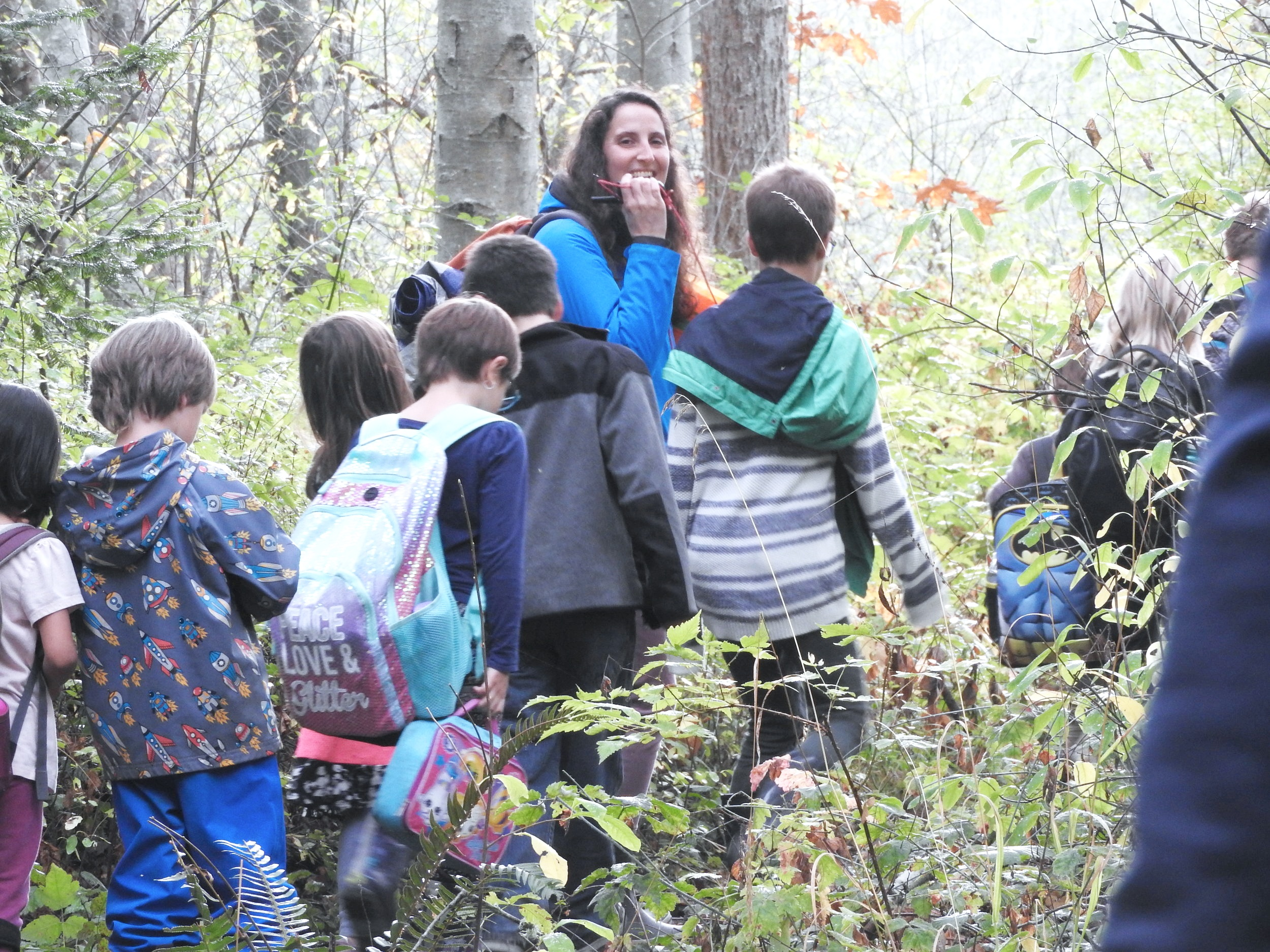 Sarah leading a group of children through the forest. Photo credit Kia Armstrong
