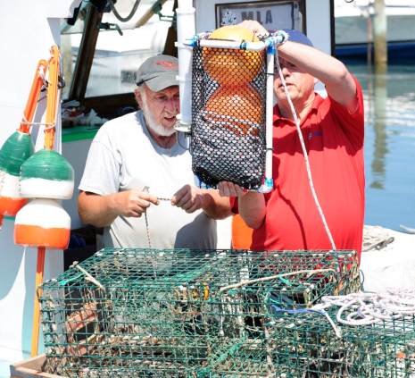Dave Casoni (left) is the first American fisher to pilot test electronic Ropeless Fishing with real gear in a fishery setting.