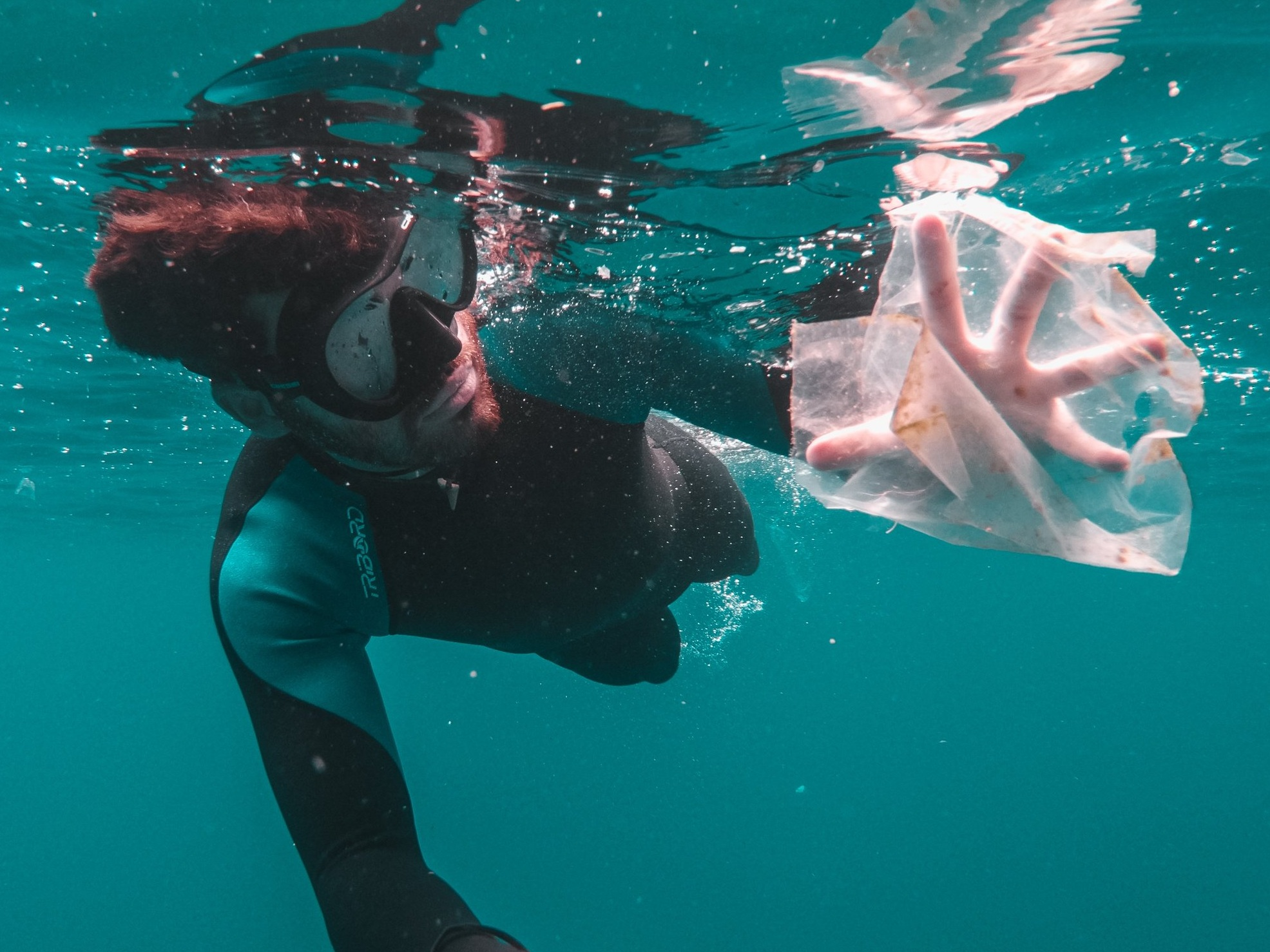 Diver with plastic bag