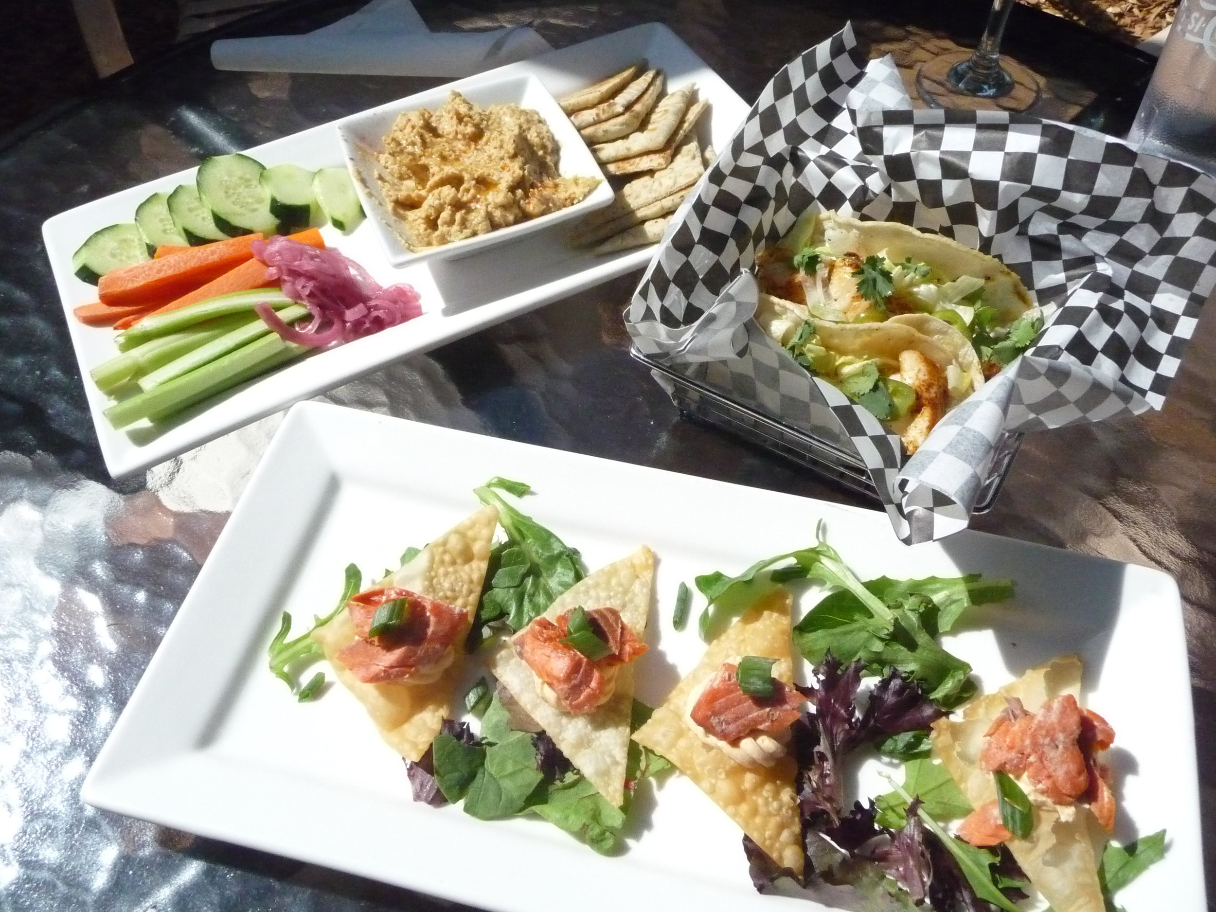 Salmon wontons, red snapper fish tacos, and hummus platter at Farrar's Bistro