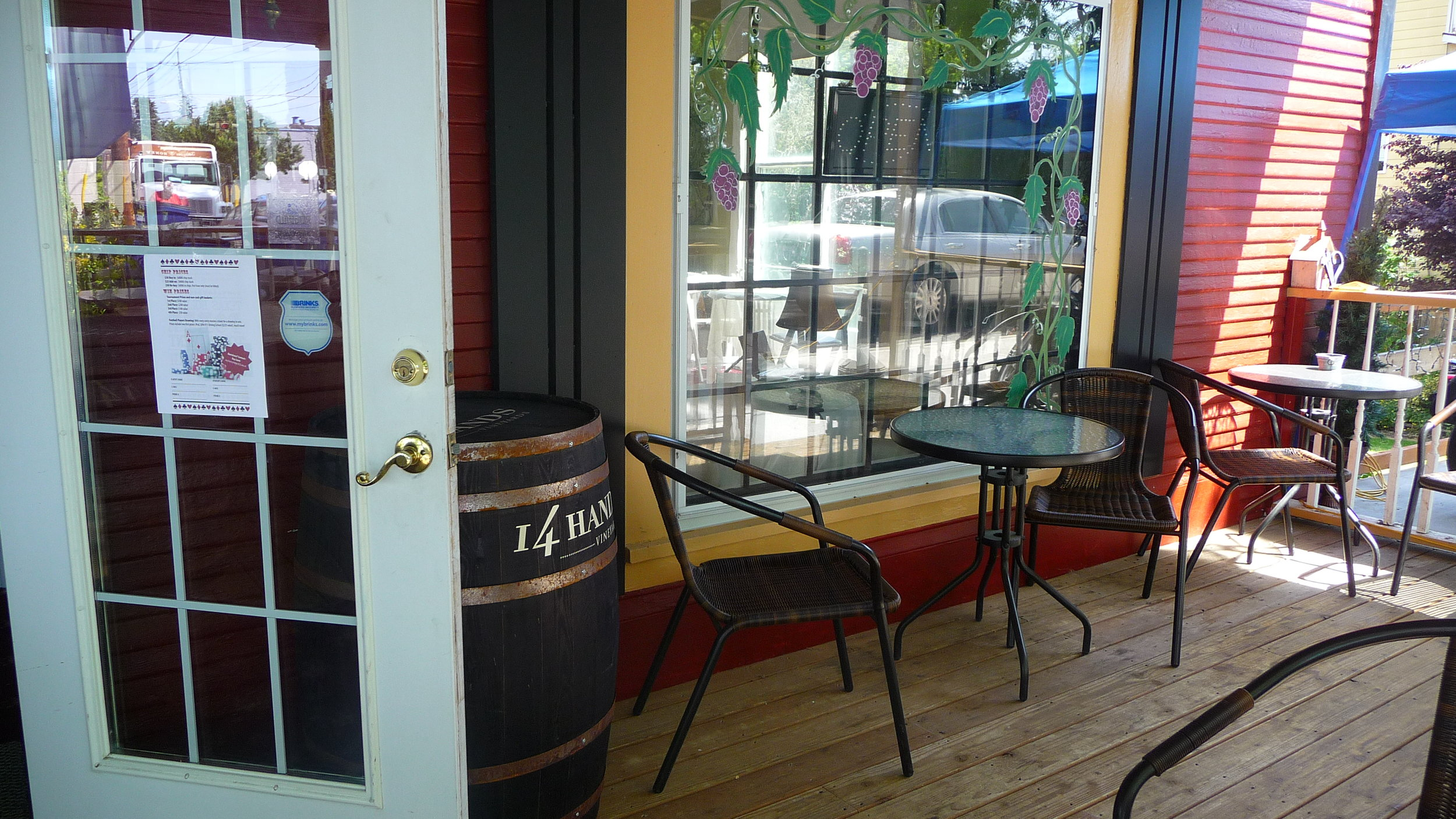 DJ's porch is an inviting space to enjoy a leisurely lunch and a glass of wine from Dee's local selection