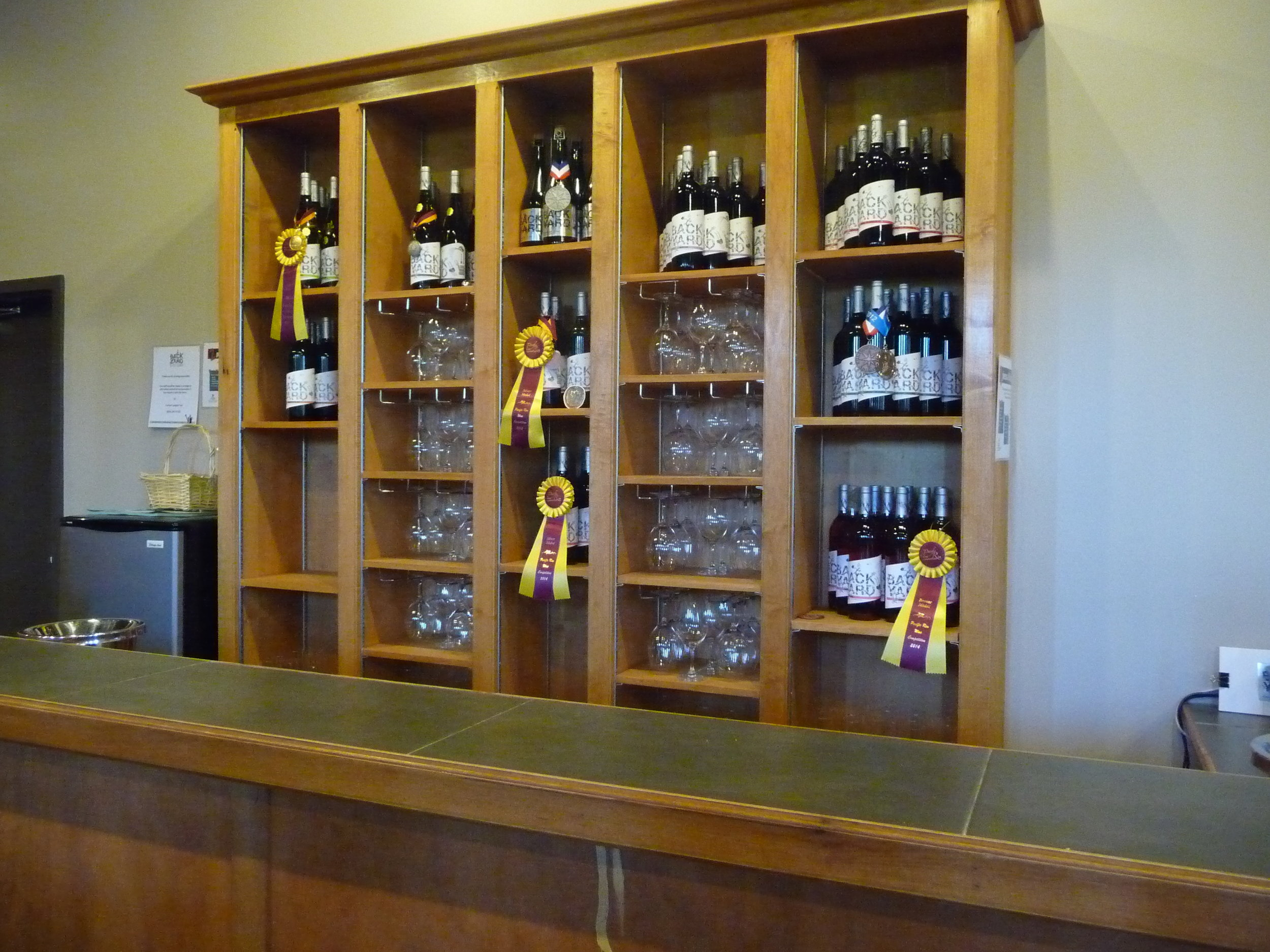 Tasting room of Backyard Vineyards. Several cheese & meat platter options are available as well as a couple paninis to pair with complimentary wine tastings.
