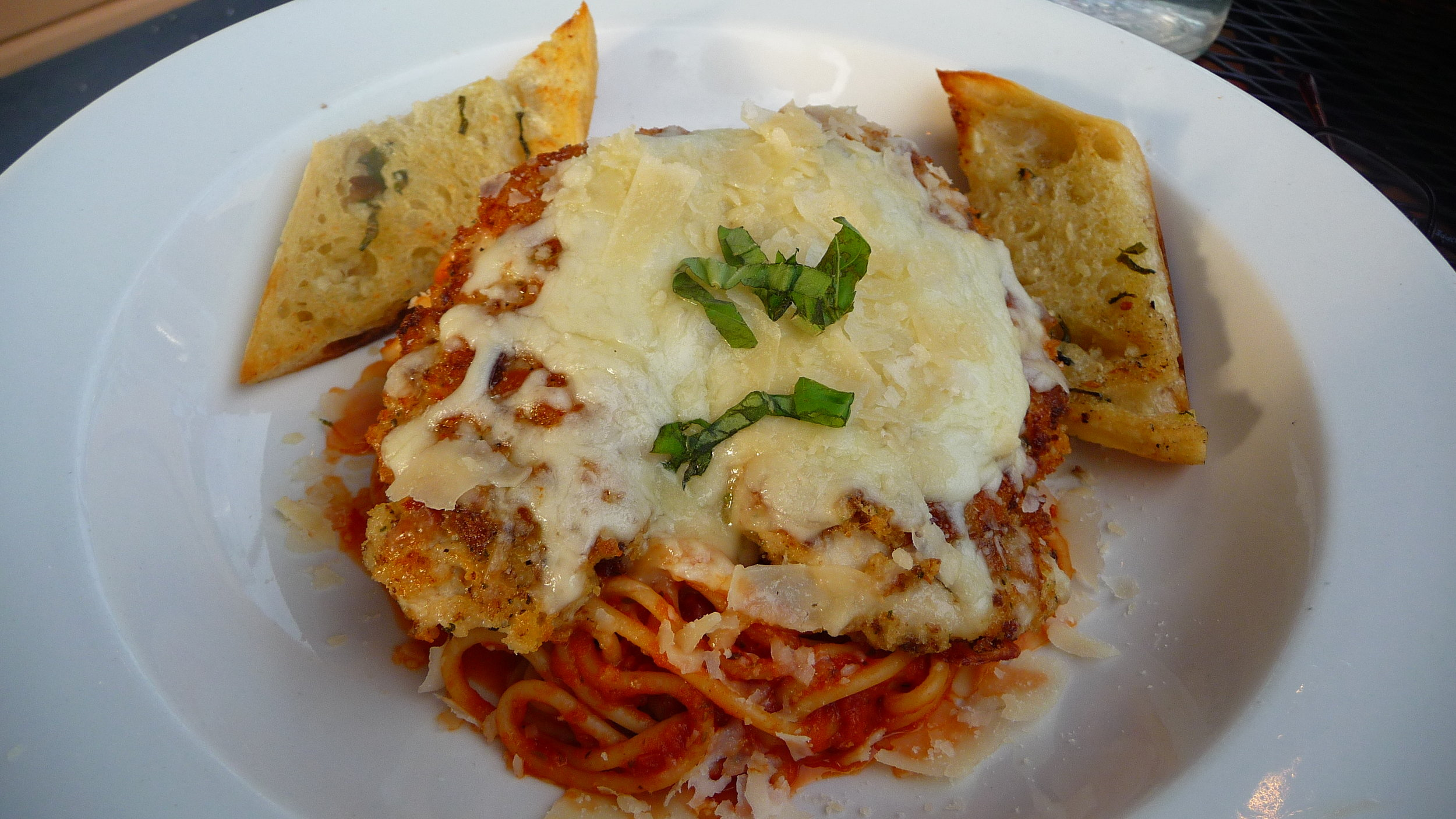 The marinara sauce of his Chicken Parmesan was fresh. The chicken had a range-free taste (don't know if it actually was) and the bed of pasta it was on only added to the frenzy he was in.