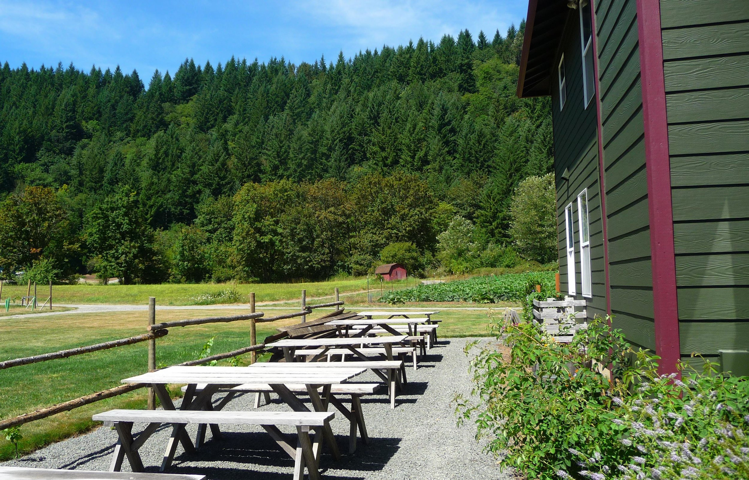 Inviting outdoor seating greets visitors to Pomeroy Cellars - near Lucia Falls Park and Moulton Falls Winery