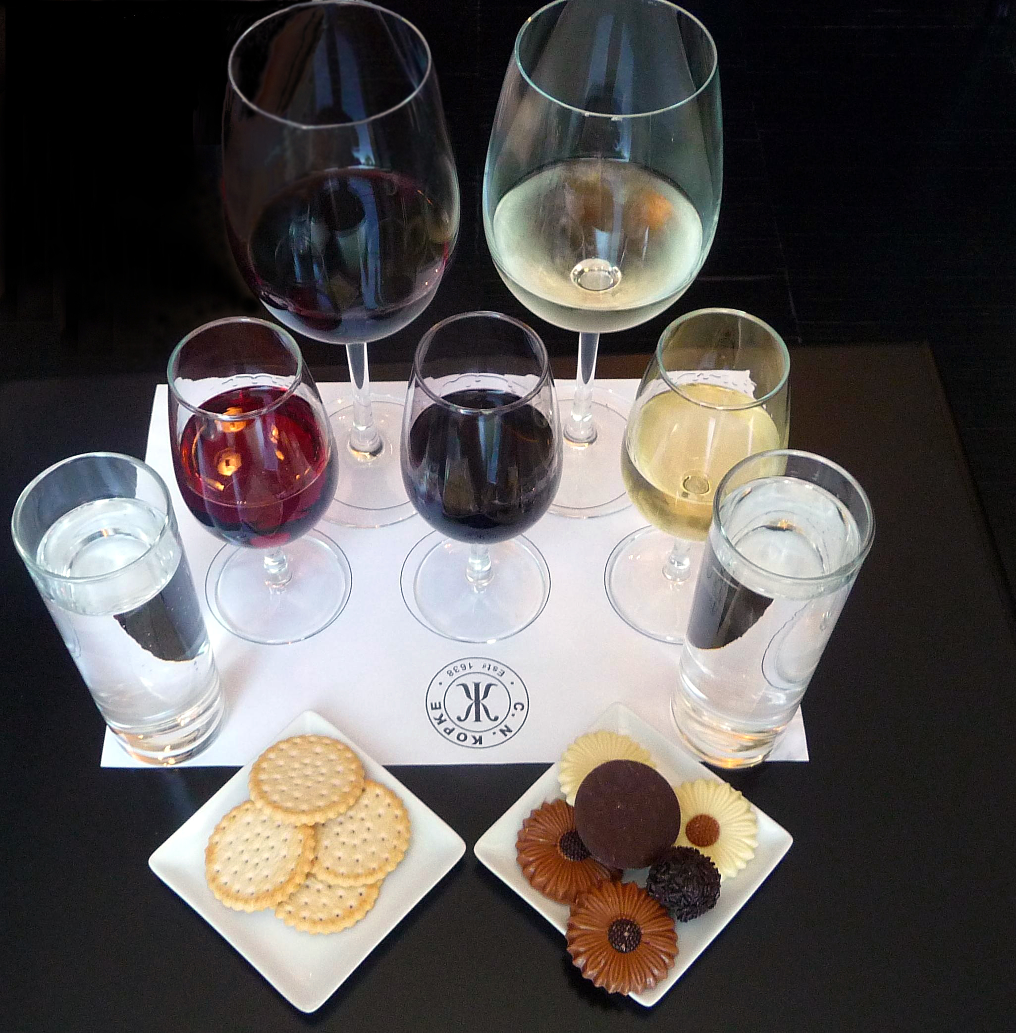 Kopke overlooks the entire waterfront of Vila de Gaia. This tasting option is an impressive plate filled with a red wine, white wine and five ports paired with crackers and chocolates as appropriate. Viki Eierdam