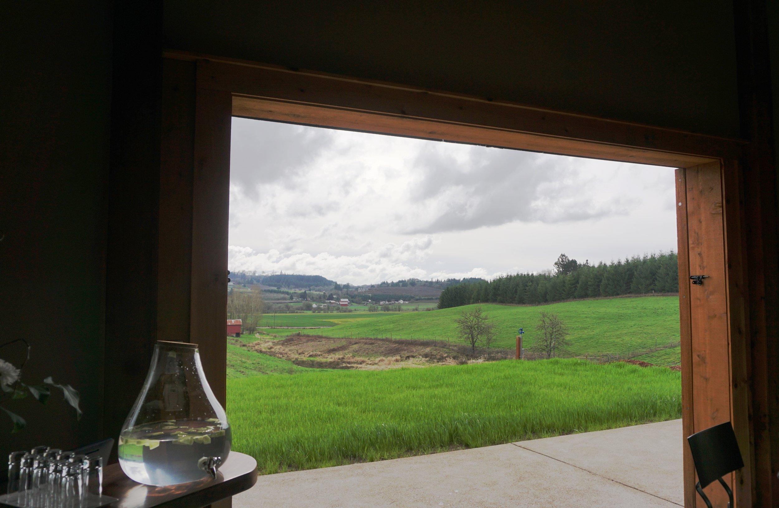 The massive sliding doors of the Northwest barn style tasting room invite the outside in at Domaine Divio. Viki Eierdam