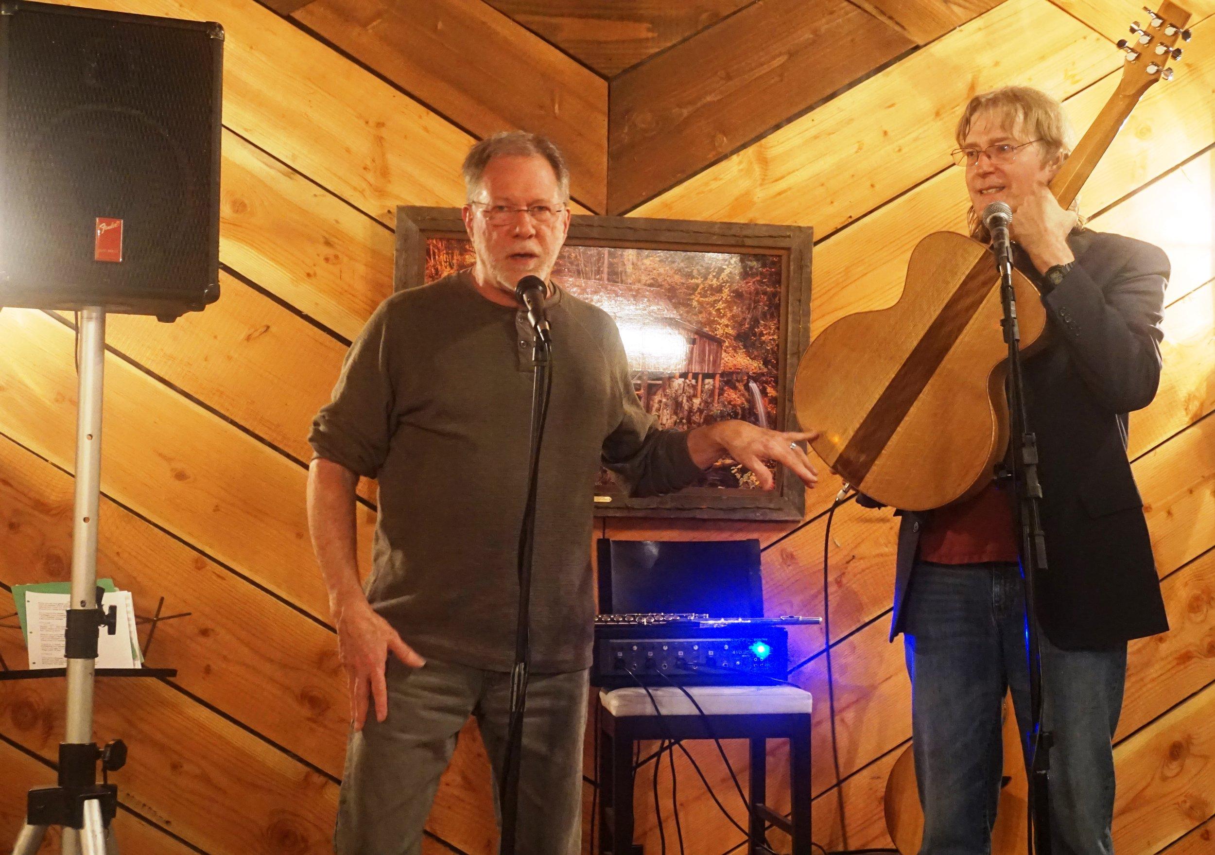 Guitar maker and local musician, Loren Schulte, explaining his inspiration for his second oak stave guitar before Doug Smith trials his handiwork. Viki Eierdam