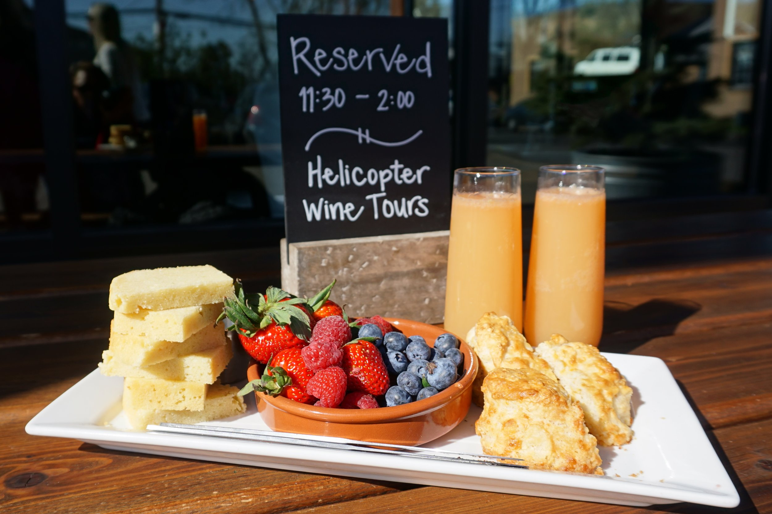 The luxury day of Willamette Valley touring via helicopter begins at Red Hills Market where passengers enjoy a glass of Argyle Winery bubbles with fruit and yummy baked goods. Viki Eierdam