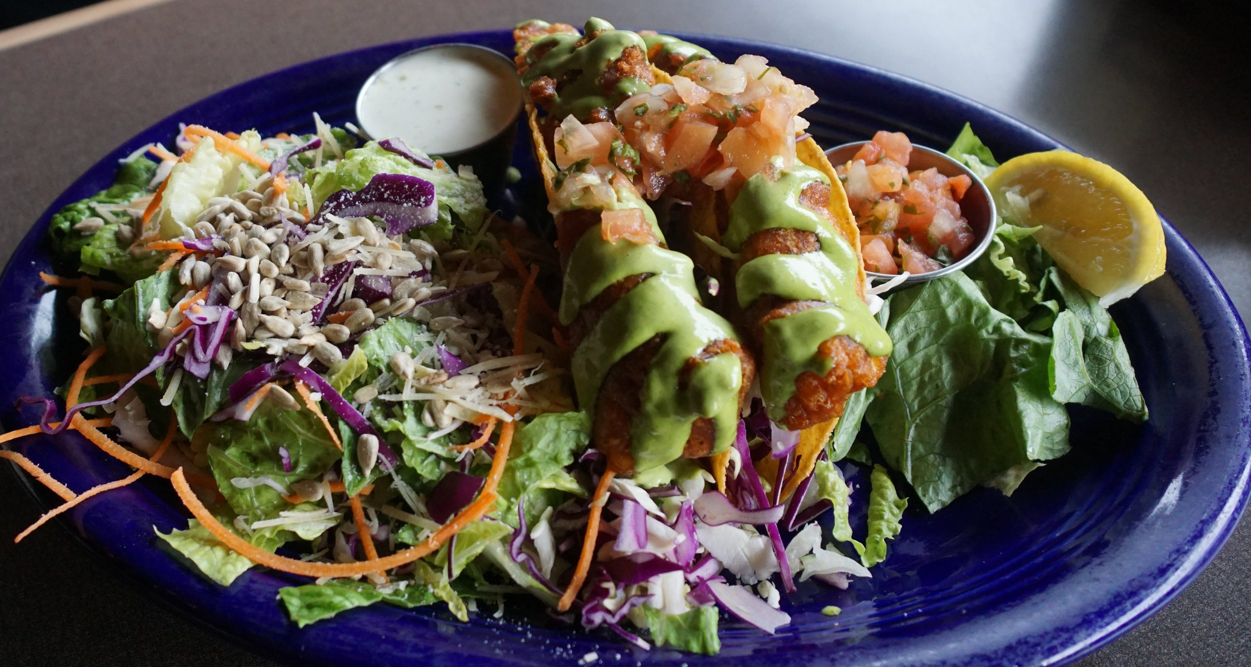 Baja Fish Tacos — a favorite menu item — feature beer-battered halibut drizzled with house-made cilantro-mayo sauce and fresh pico de gallo. Photo courtesy of Viki Eierdam.