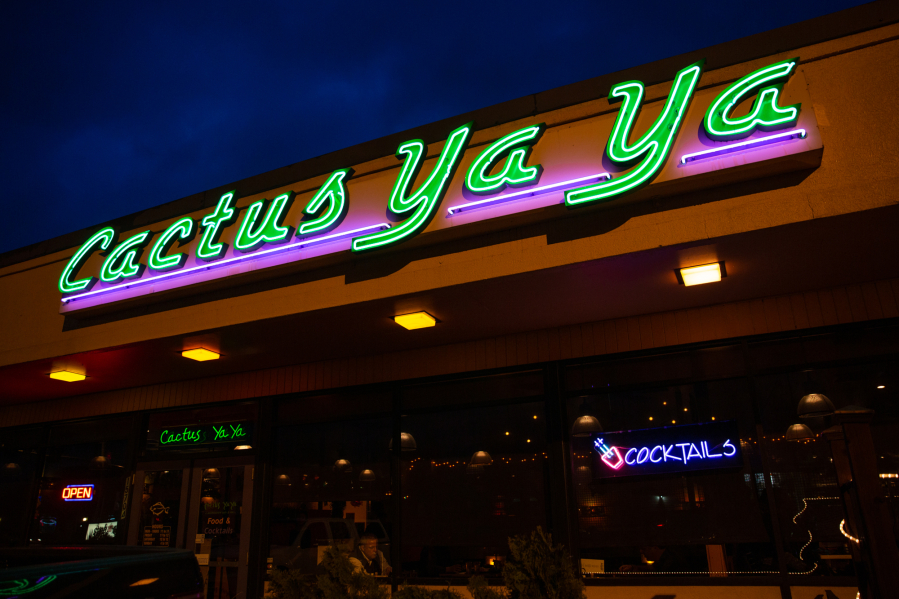 """Cactus Ya Ya's neon sign shines in east Vancouver on a recent Friday night. The restaurant replaced a Minit Mart 25 years ago in what was once Vancouver's rural eastern frontier. """"The first couple years were a little spooky,"""" said owner Jim Rettig. """"There was nothing out here."""" Elayna Yussen for The Columbian"""