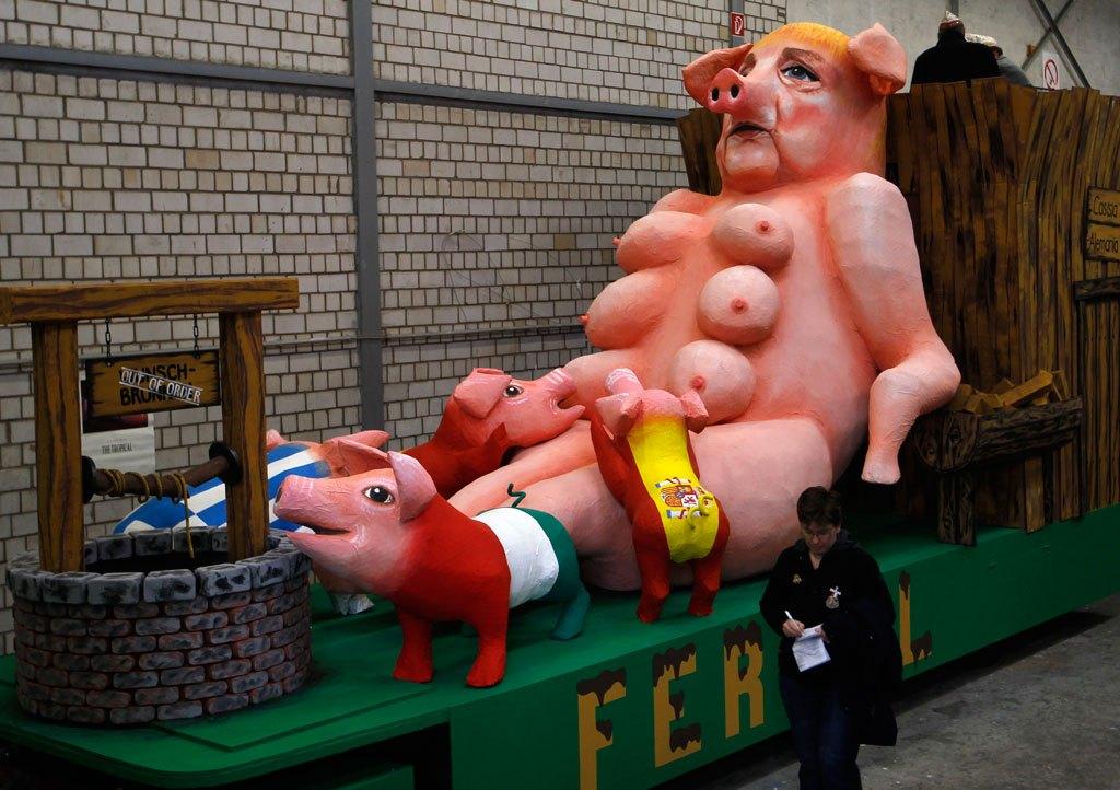 Merkel with piglets