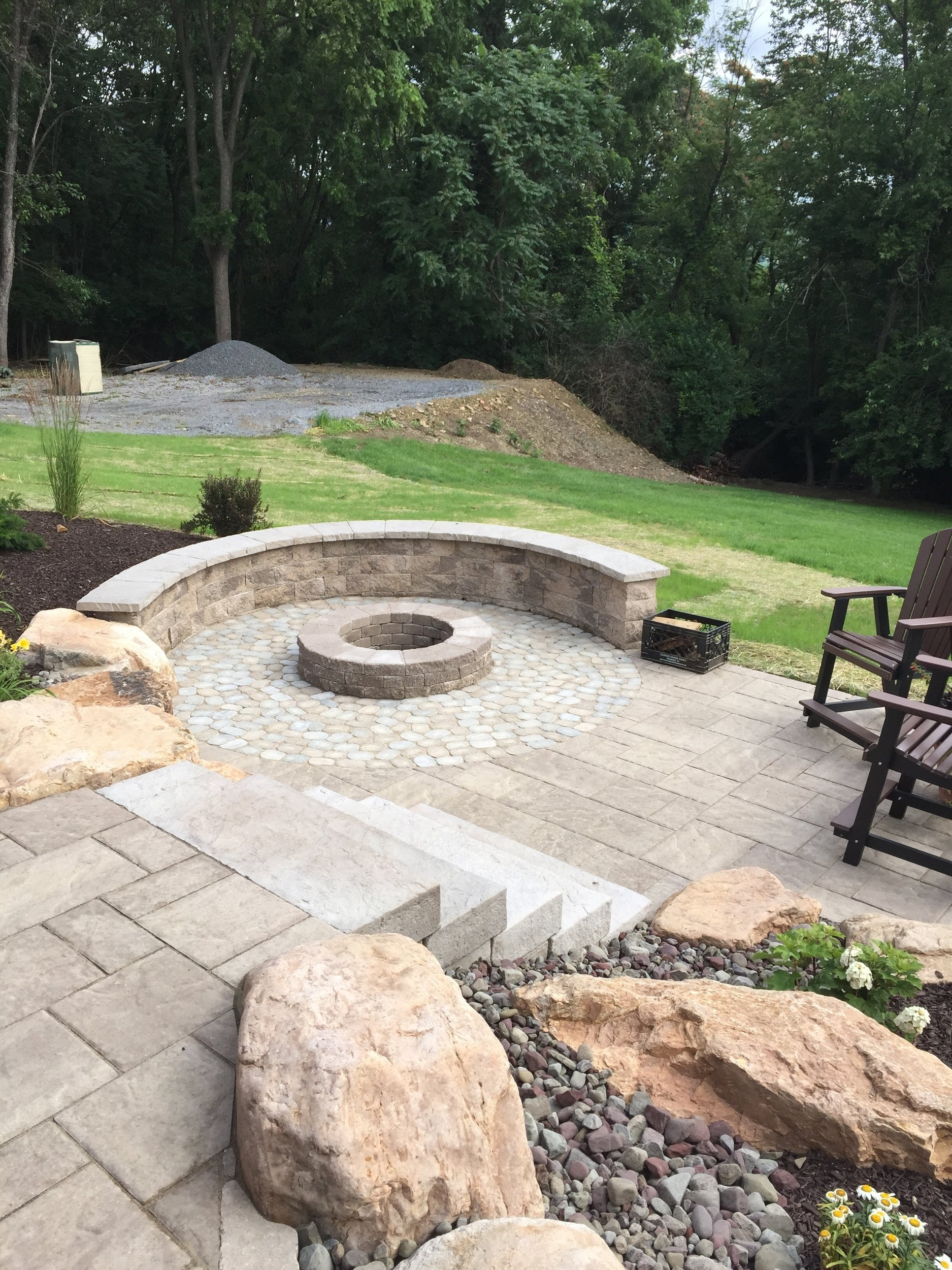 Expert landscape design with a fire pit in Schuylkill County, PA