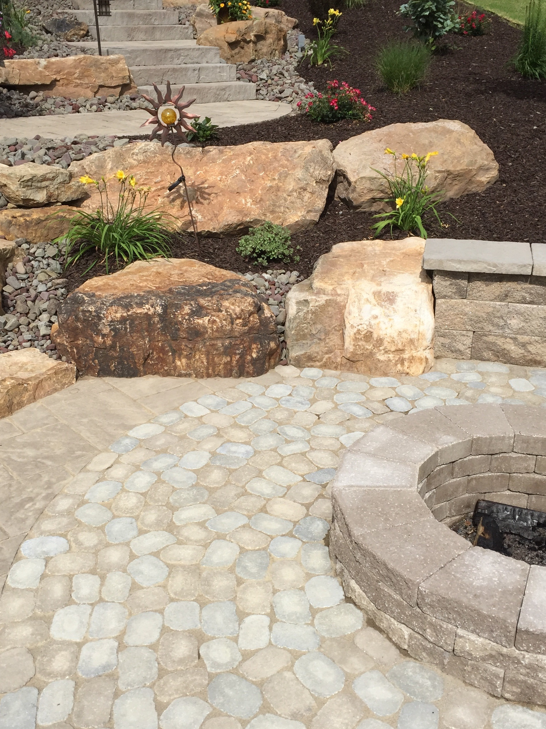 Professional landscape design with a fire pit inWayne Township, PA