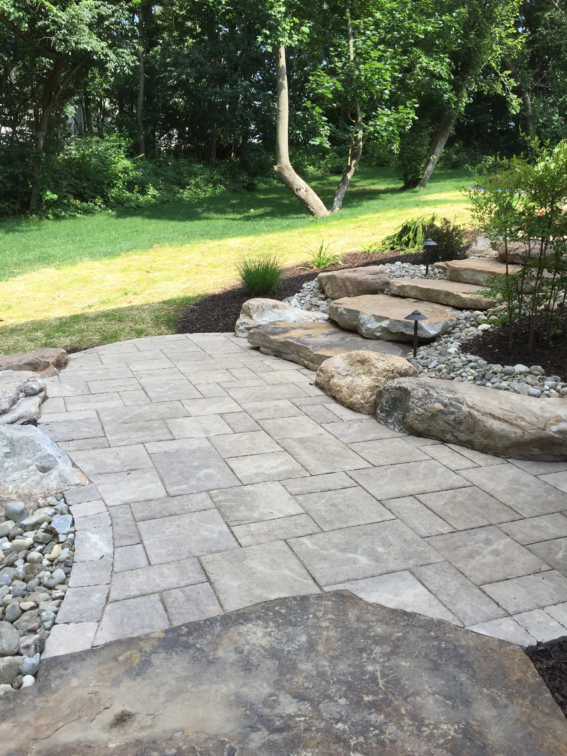 Top backyard landscape design with an outdoor kitchen by landscape contractor in Pottsville, Pennsylvania