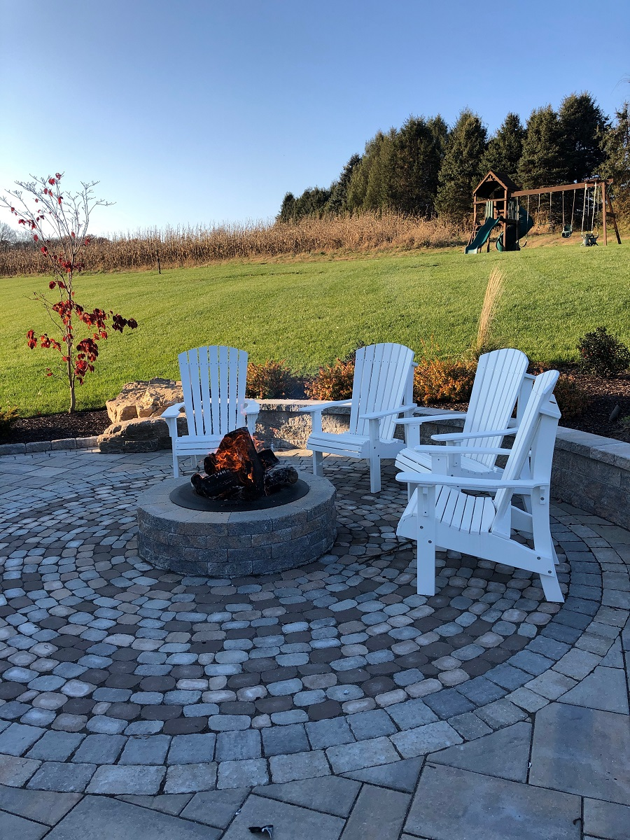 Paver patio with outdoor fireplace in Outdoor fireplace in Wayne Township PA