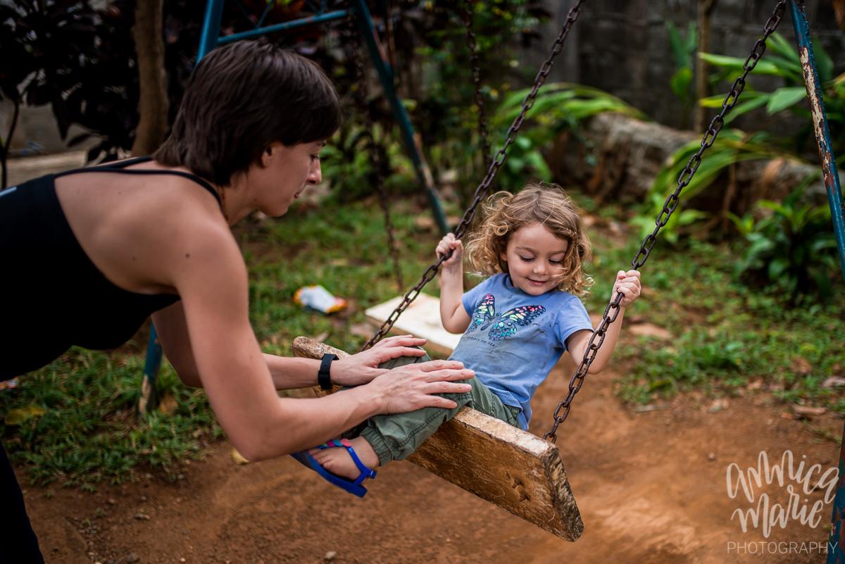 toddler swinging mom pushing