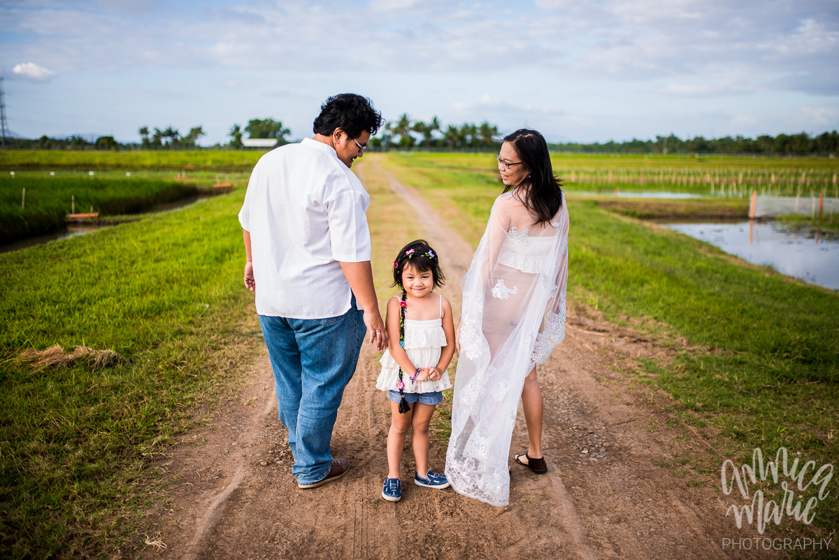 These rice fields are very special to this family. Buyung (left) works here, at the International Rice Research Institute in Los Baños, Laguna, Philippines.