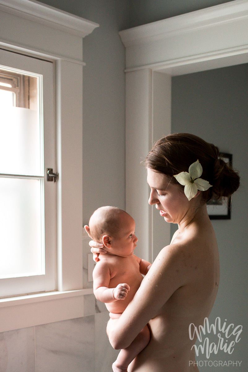 mom and baby standing in the window