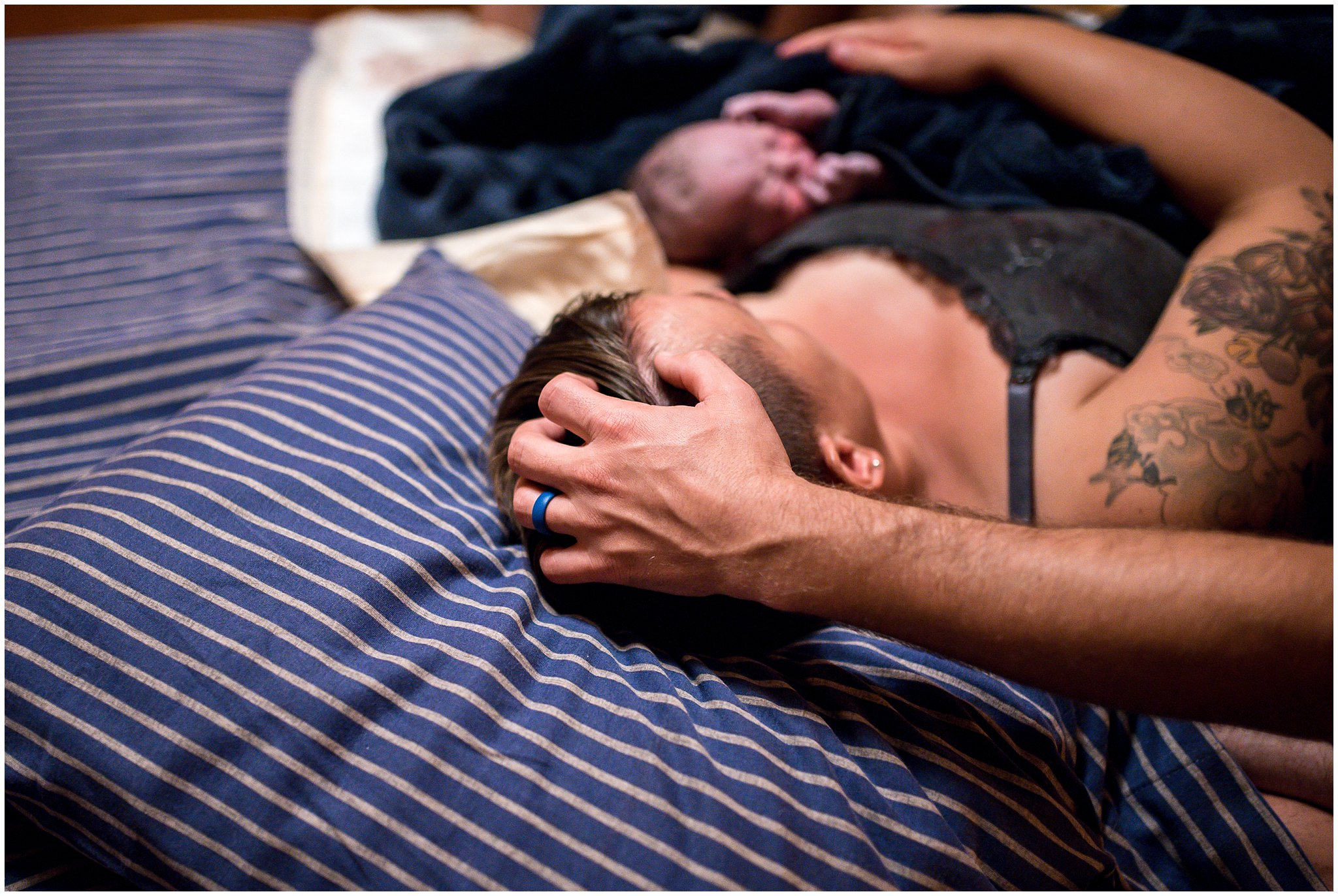 Grand Rapids home birth photographer - Annica Quakenbush - husband stroking wife's hair