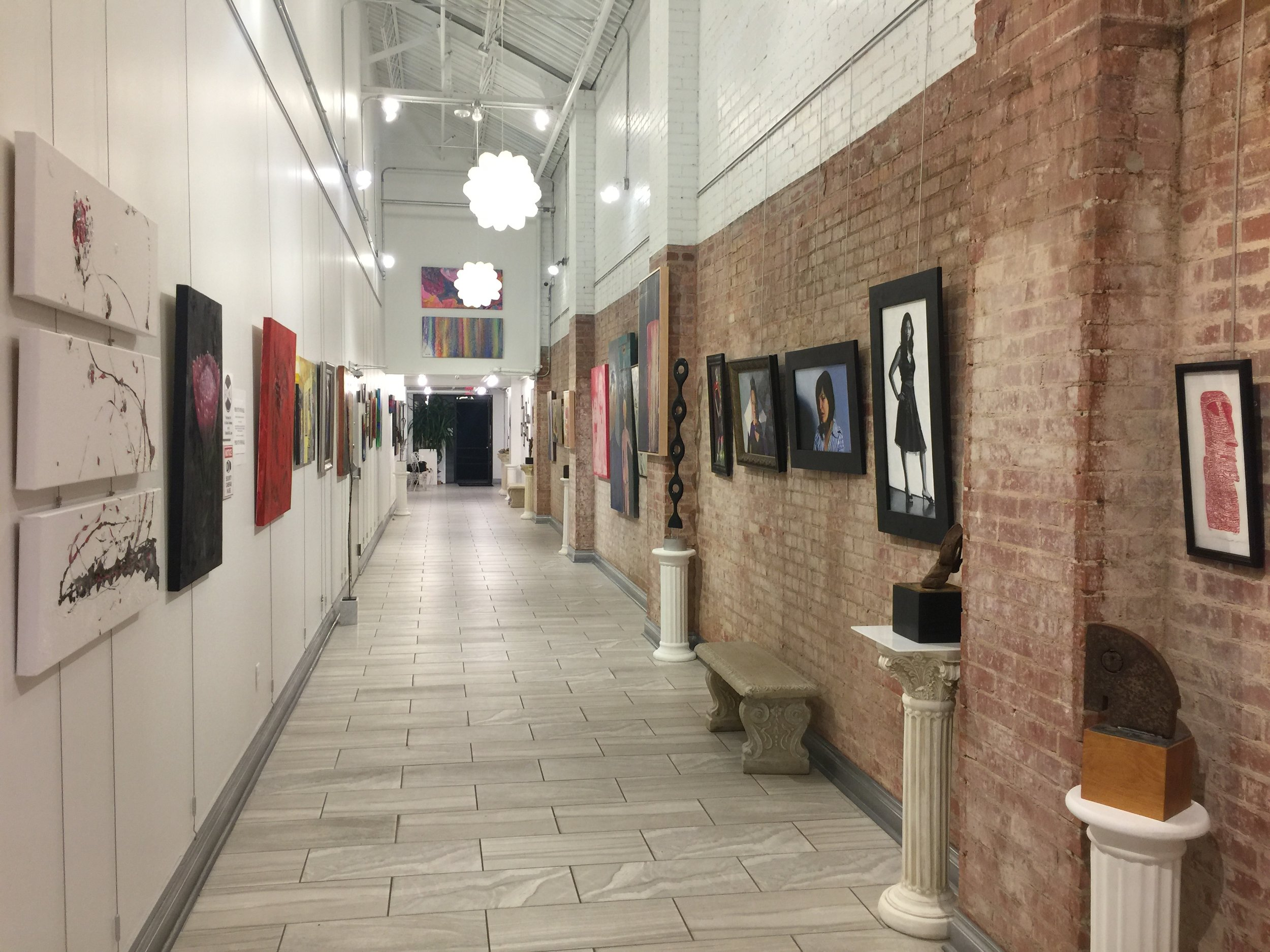 Installation view facing North, with painting by Teddi Fokas on the left and work by Kjelshus Collins, Ryan Pack, and Michael Hanes on the right
