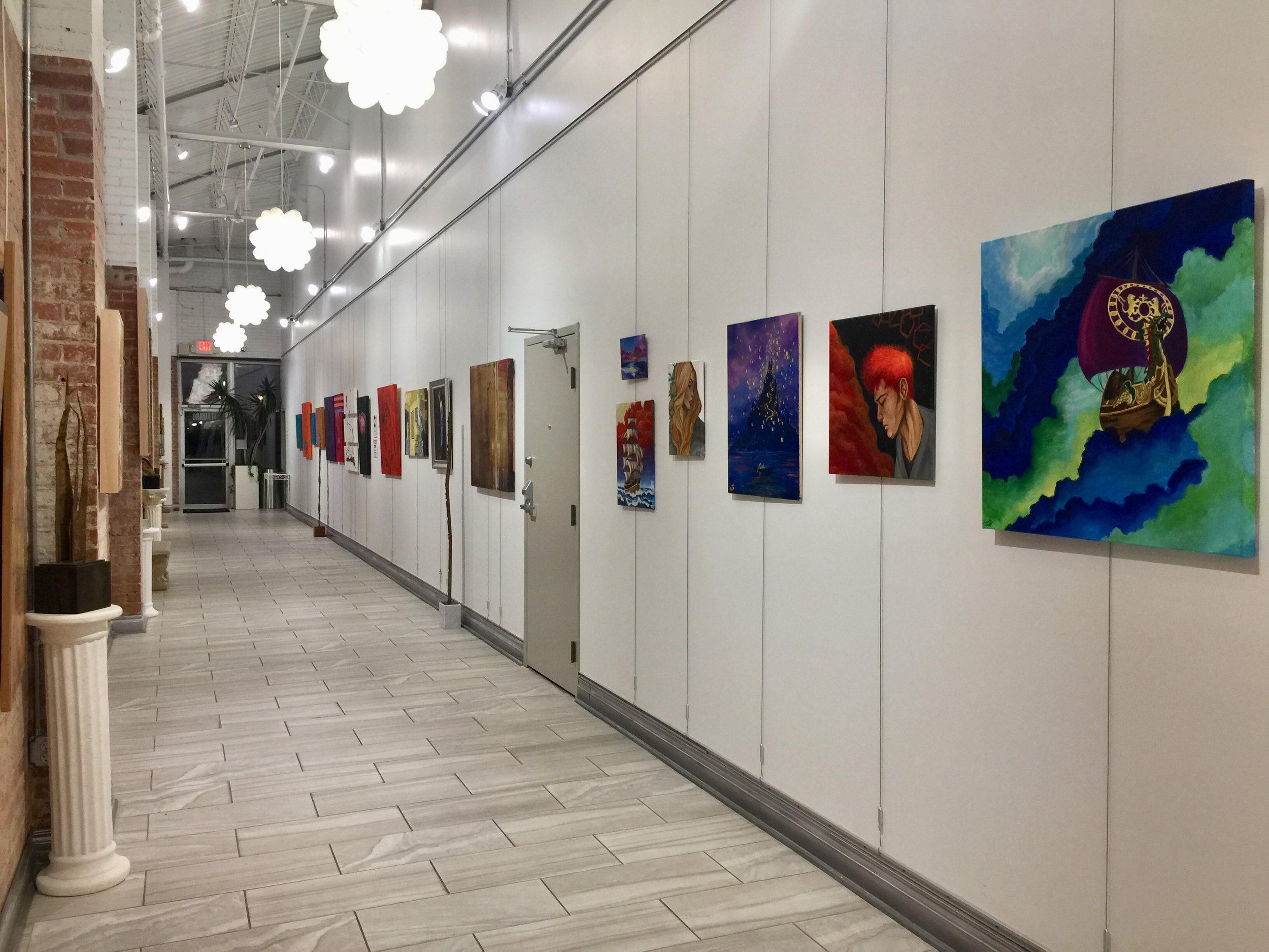 Painting by Samantha Hurst in the right foreground
