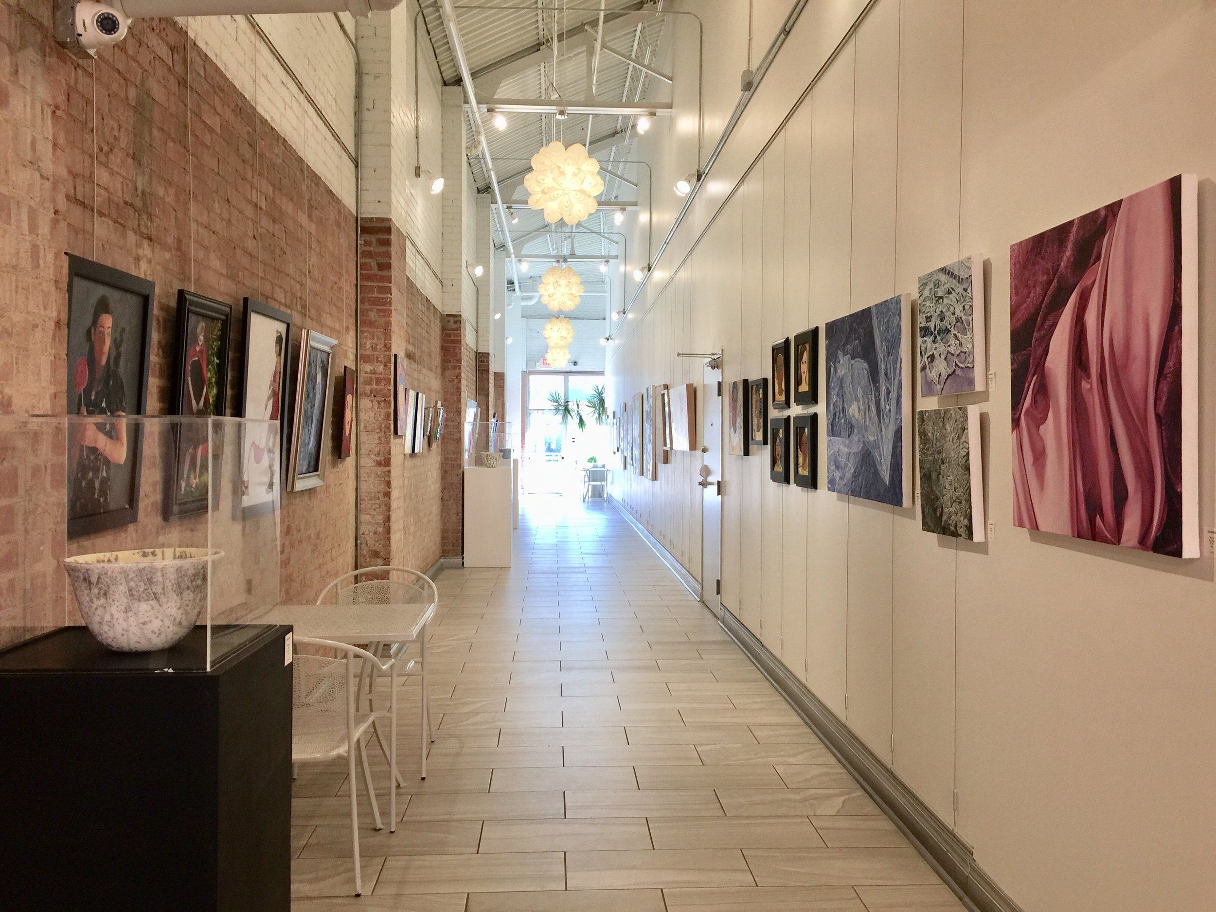 Installation view facing South, featuring Ryan Pack on the left and Erica Bonavida on the right, and Debra Ashley's glass work