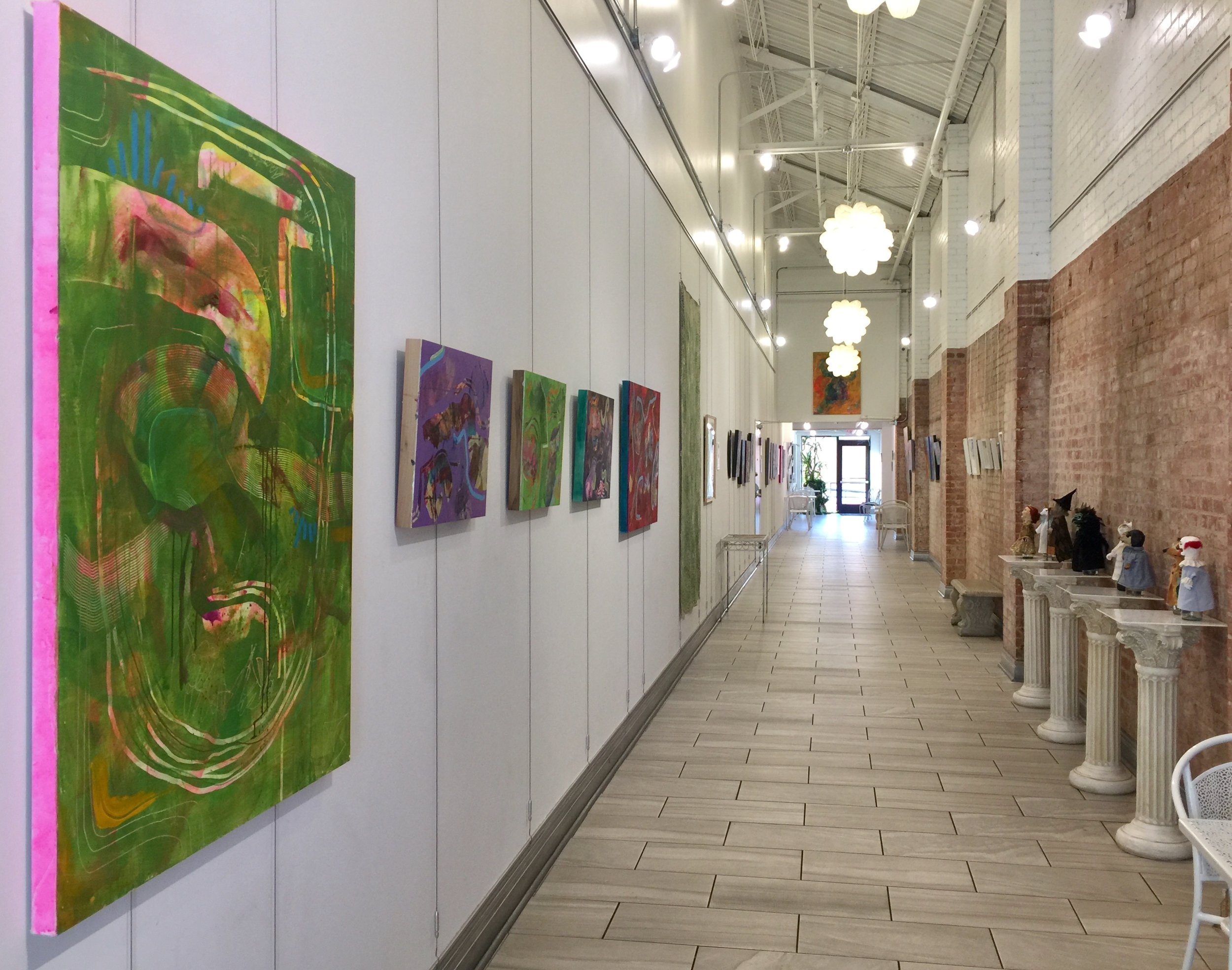 Installation view facing North, featuring Virginia Sitzes on the left