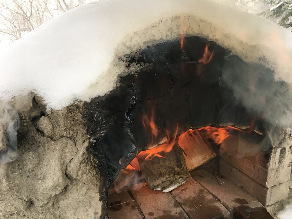 Snowy clay oven mouth.jpg