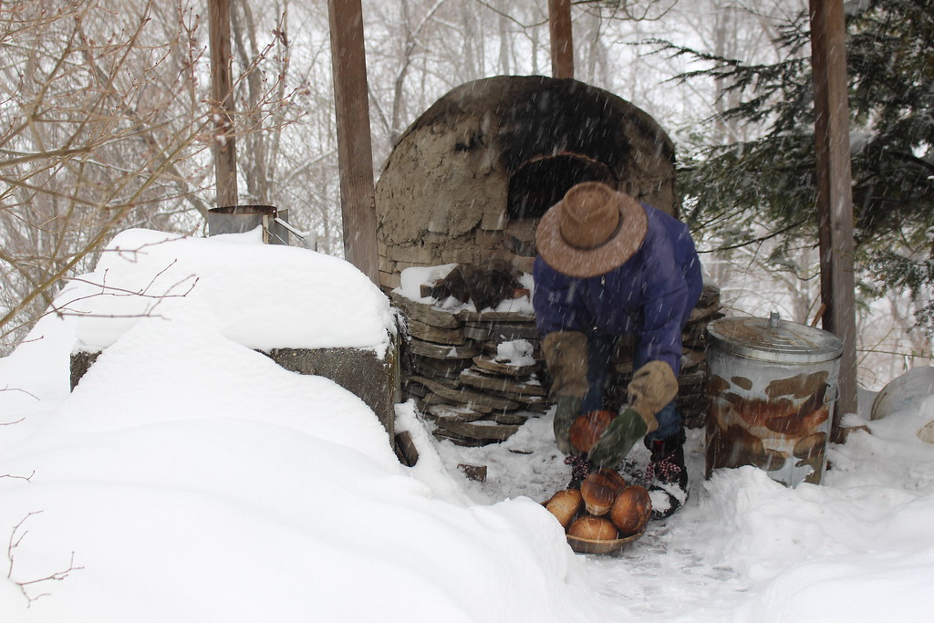 Mom with clay oven in snow.jpg