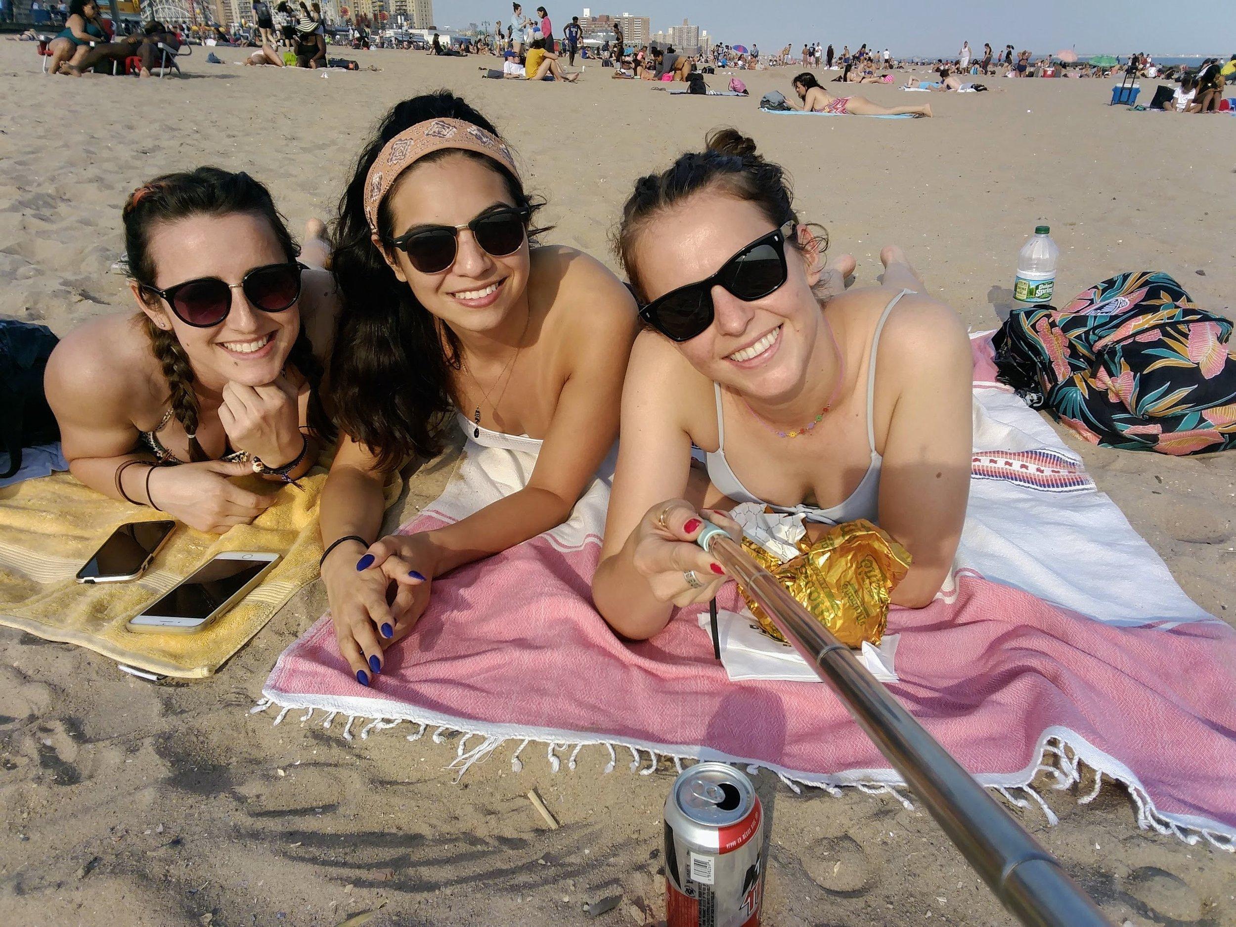 Christina, Mel, and I lounging at Coney Island