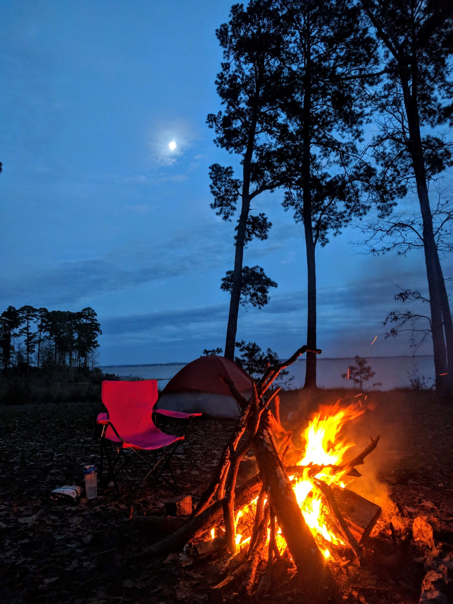 A full moon and a full campfire