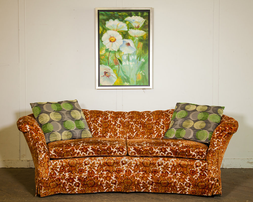 """The design of this sofa speaks to BOHO lovers. To find a vintage sofa like this that exudes today's fashion, anyone who wants the chic """"in"""" look will jump for joy."""