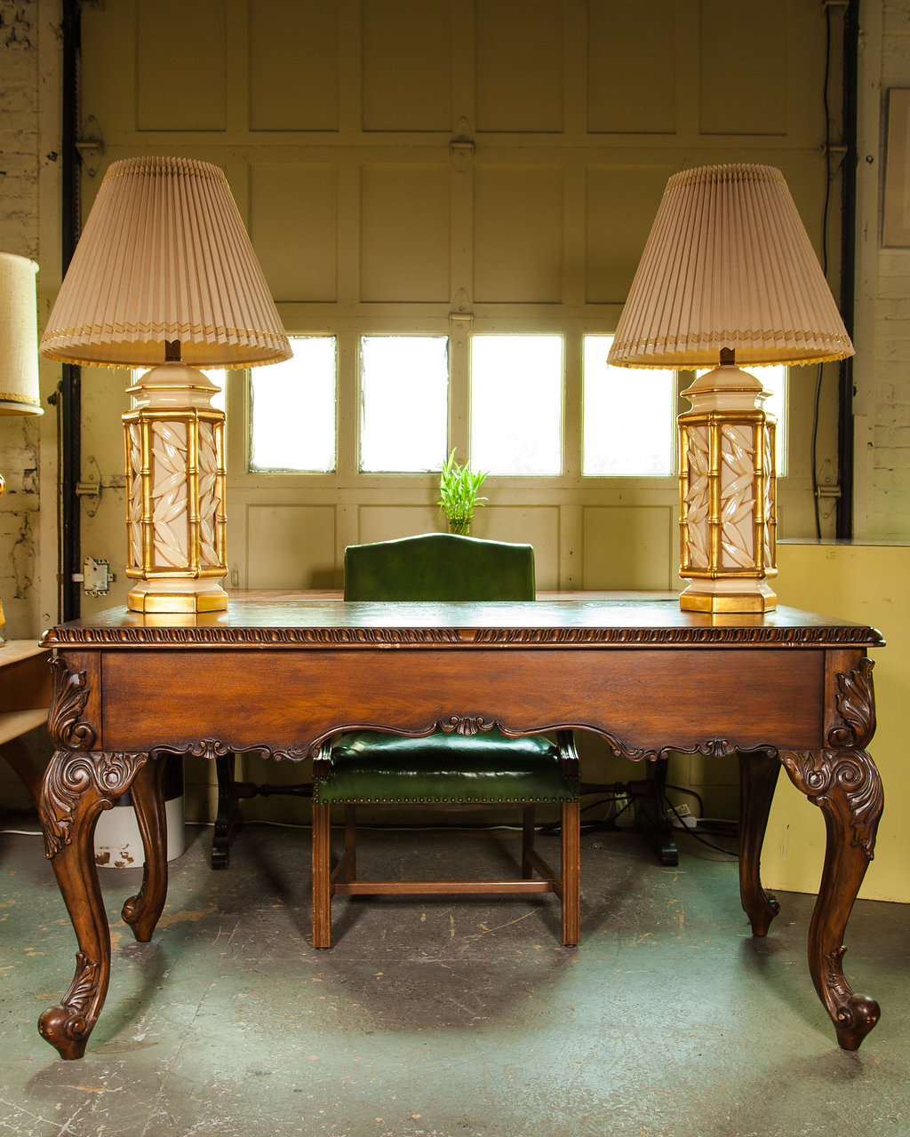 Nothing says horror movie like like a solid wood, antique desk with intricate detail on its legs. This beautiful piece could scare the best of 'em into getting that work done to celebrate the times.