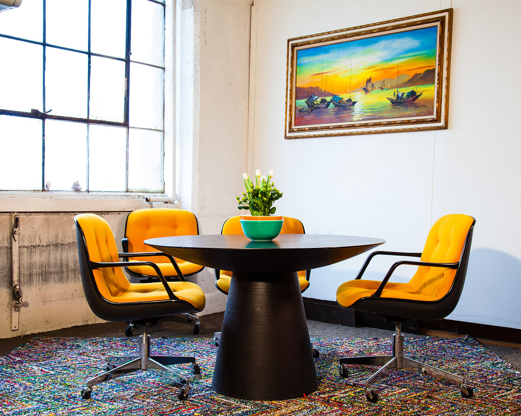 The 1960s and 1970s look like they were meant for each other with this dining room set – a Black Beehive Table with Golden and Black  Steelcase Ames-Style wheeled chairs . This is a fun treat ready to go for the Halloween and Thanksgiving holiday season.